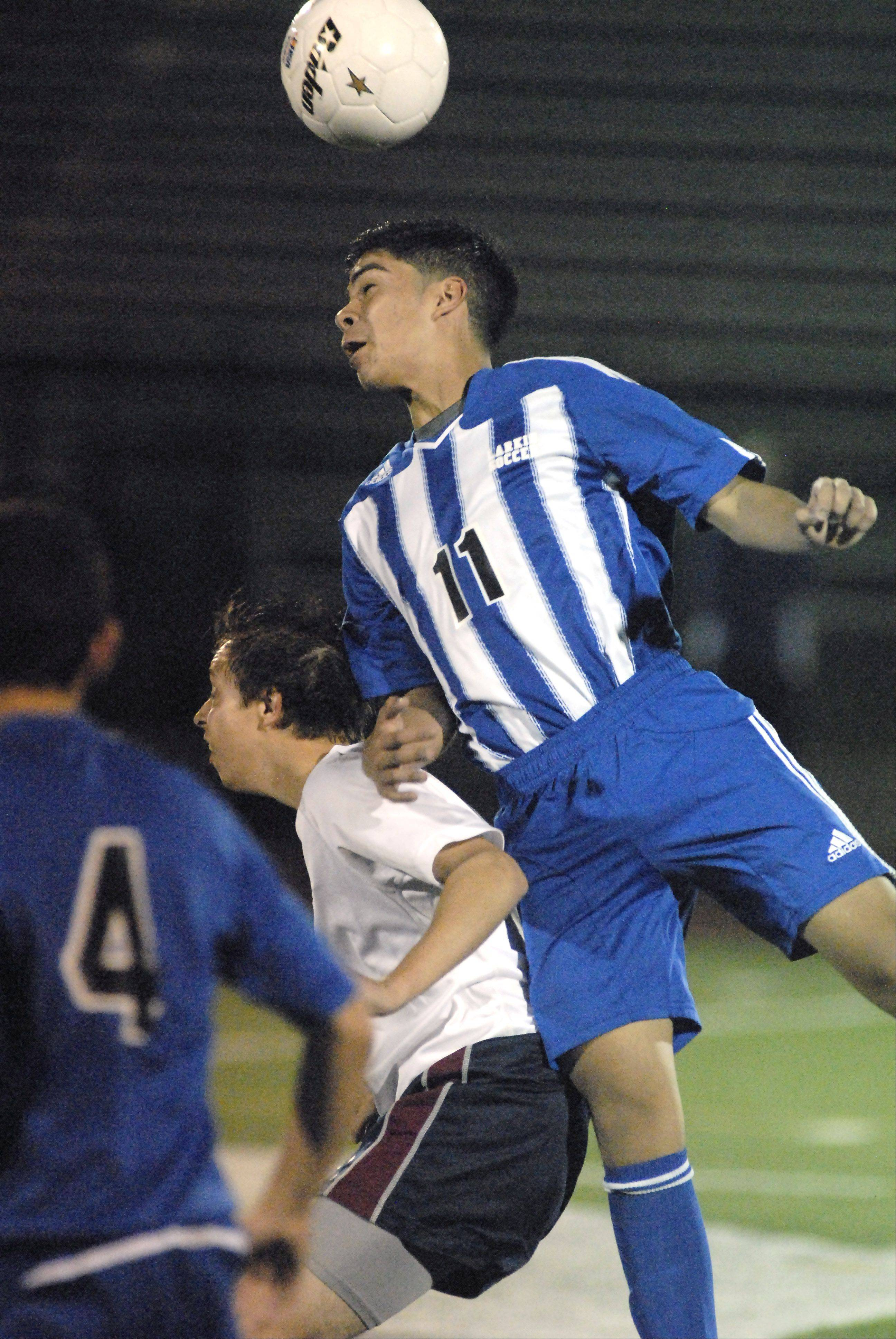 Larkin's Diego Ramirez heads the ball over South Elgin's Quinn Uveges in the second half on Tuesday, October 23.