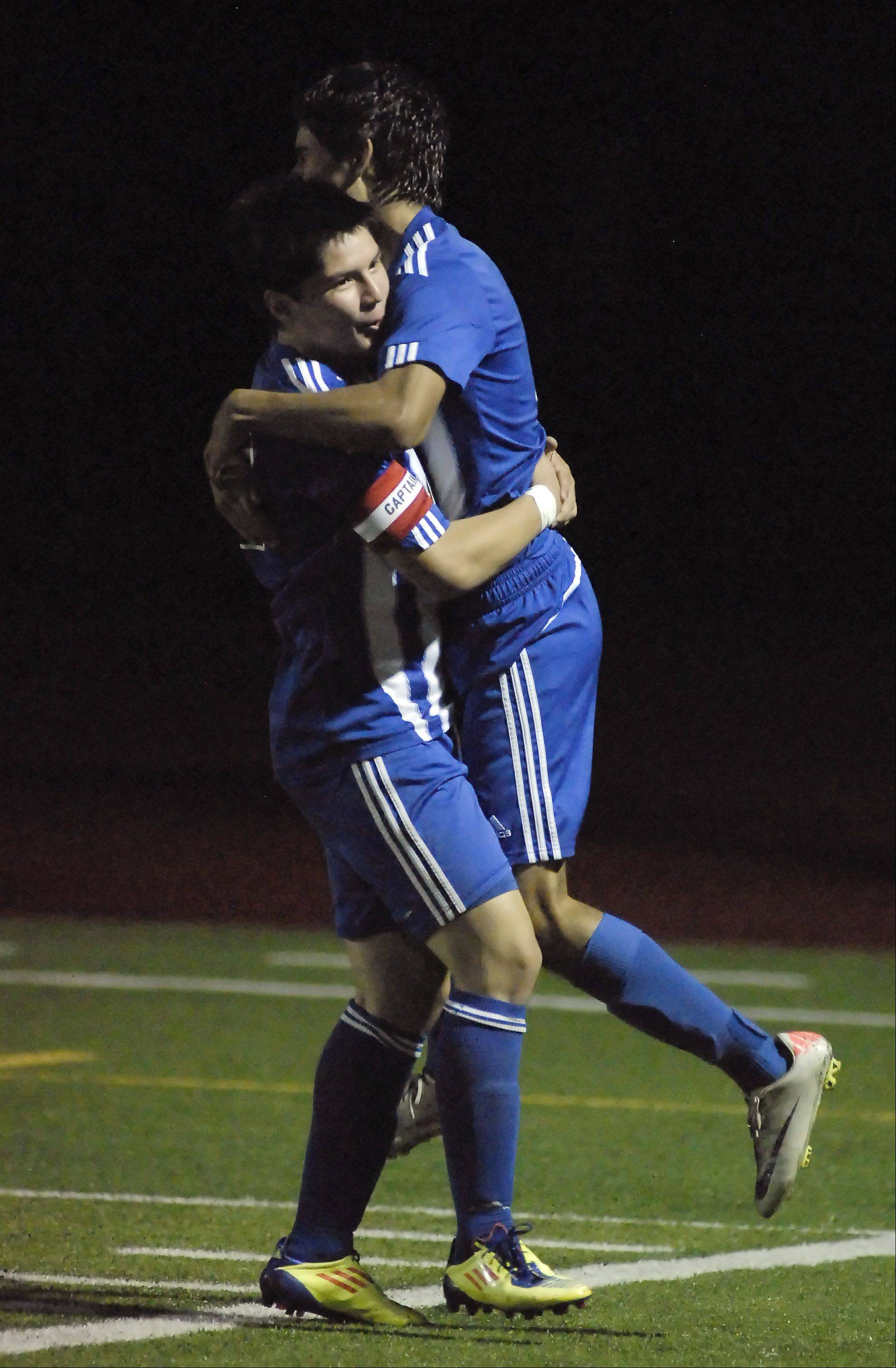 Larkin's Erik Rodriguez hoists up Jazael Medina after Medina scores a goal in the first half to tie up the match with South Elgin on Tuesday, October 23.