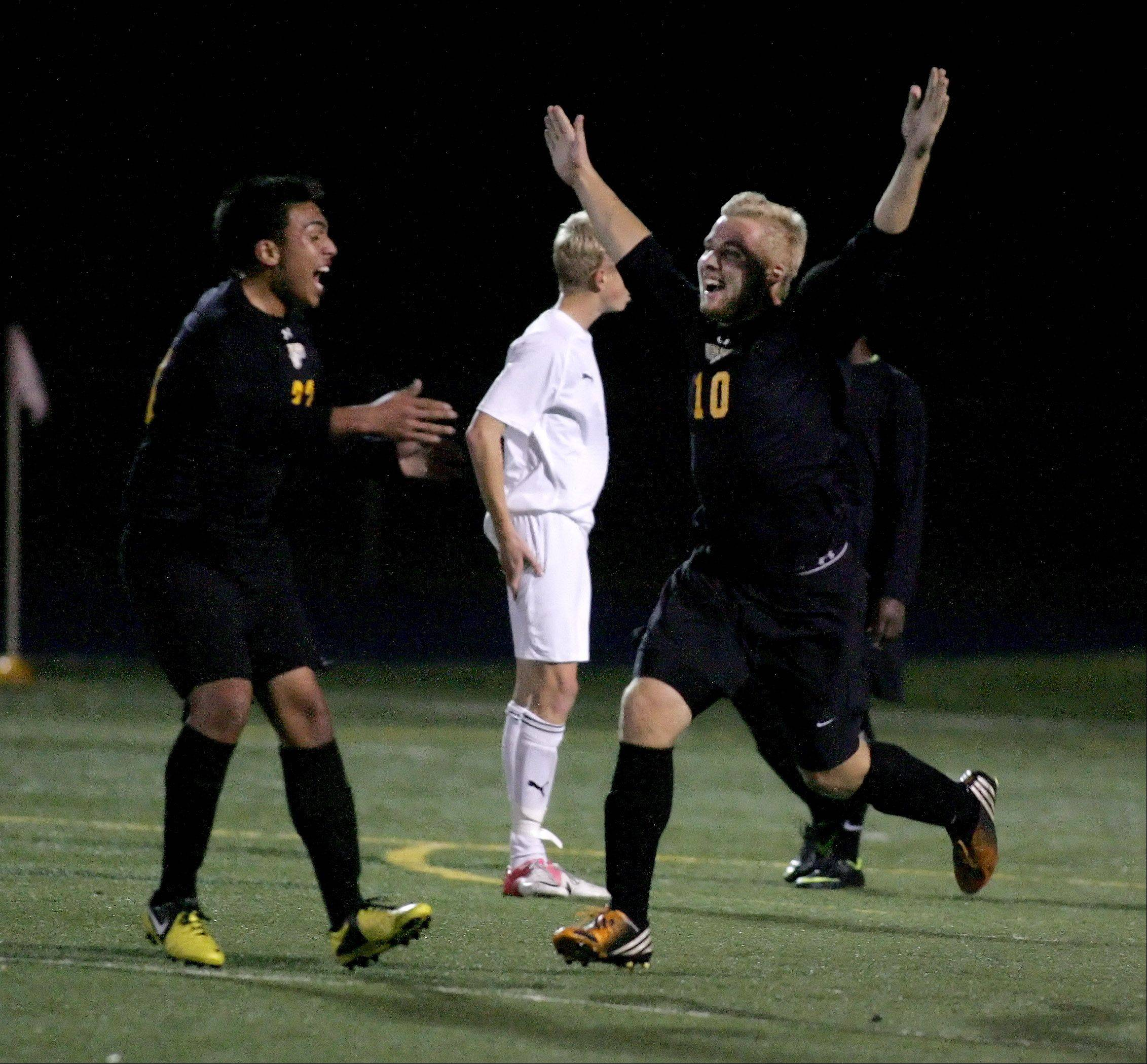 Jake Goehring of Metea Valley, right, celebrates after scoring a goal in the second half against Wheaton Warrenville South in boys Class 3A sectional soccer in West Chicago. Metea Valley won 1-0.