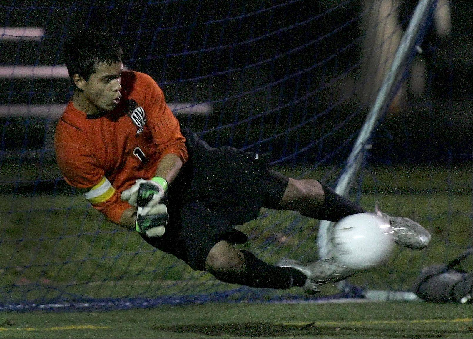 Gabe Gongora-Falla of Metea Valley makes another save at goal late in the second quarter against Wheaton Warrenville South during boys Class 3A sectional soccer in West Chicago.