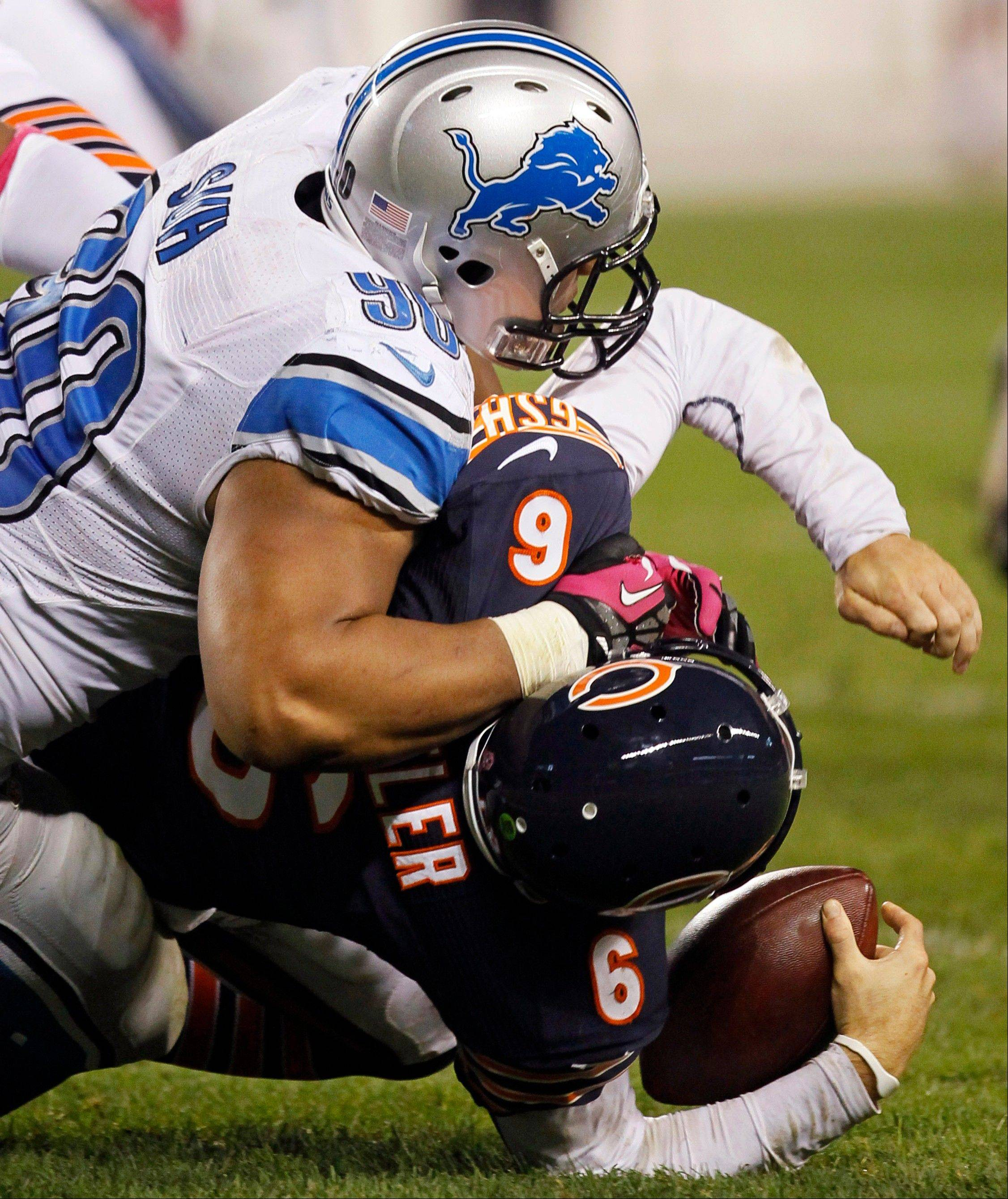 Chicago Bears quarterback Jay Cutler (6) is sacked by Detroit Lions defensive tackle Ndamukong Suh (90) in the first half of an NFL football game in Chicago, Monday, Oct. 22, 2012.