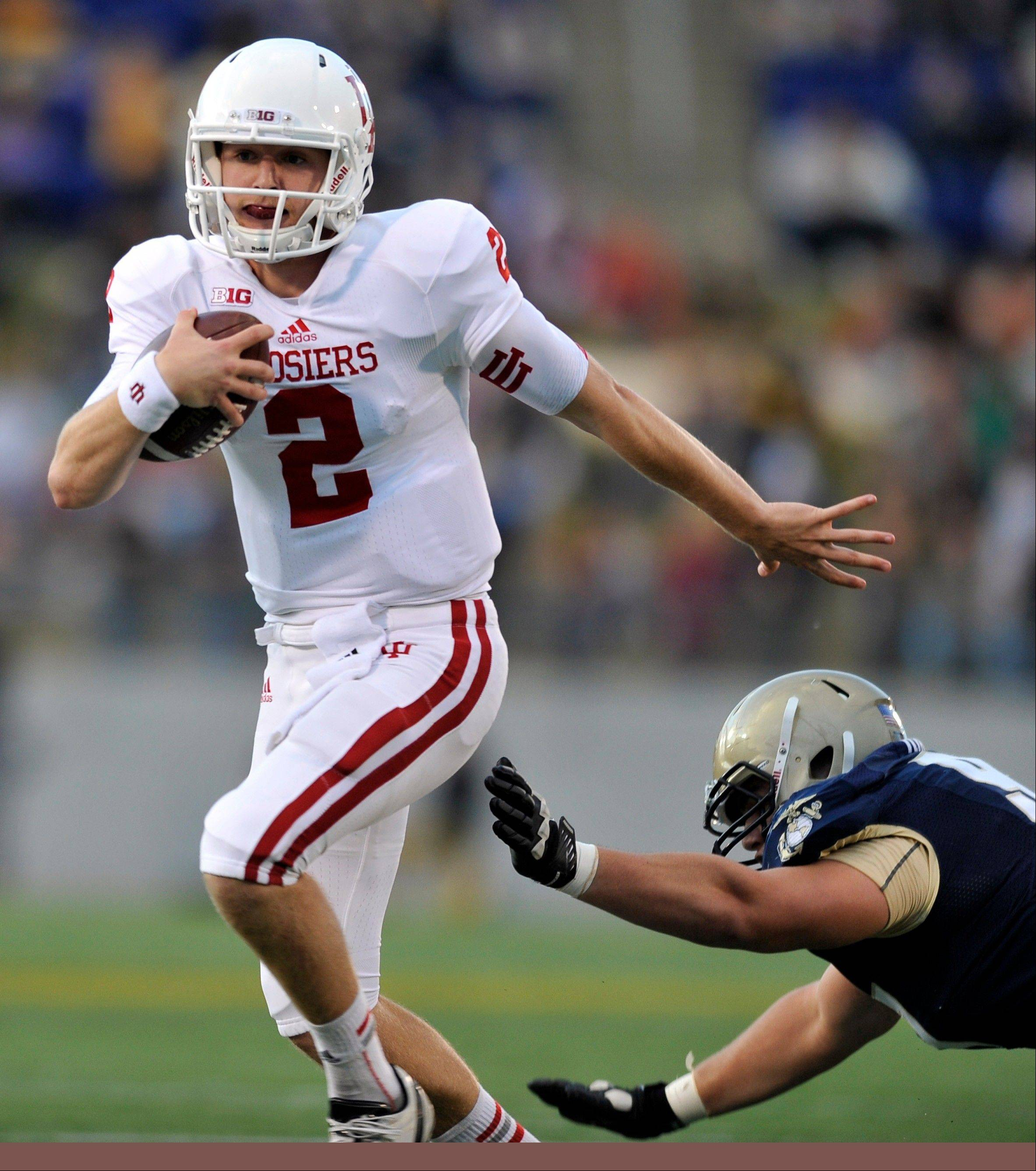 Indiana quarterback Cameron Coffman runs the ball against Navy Saturday during the second half in Annapolis, Md. Navy won 31-30.