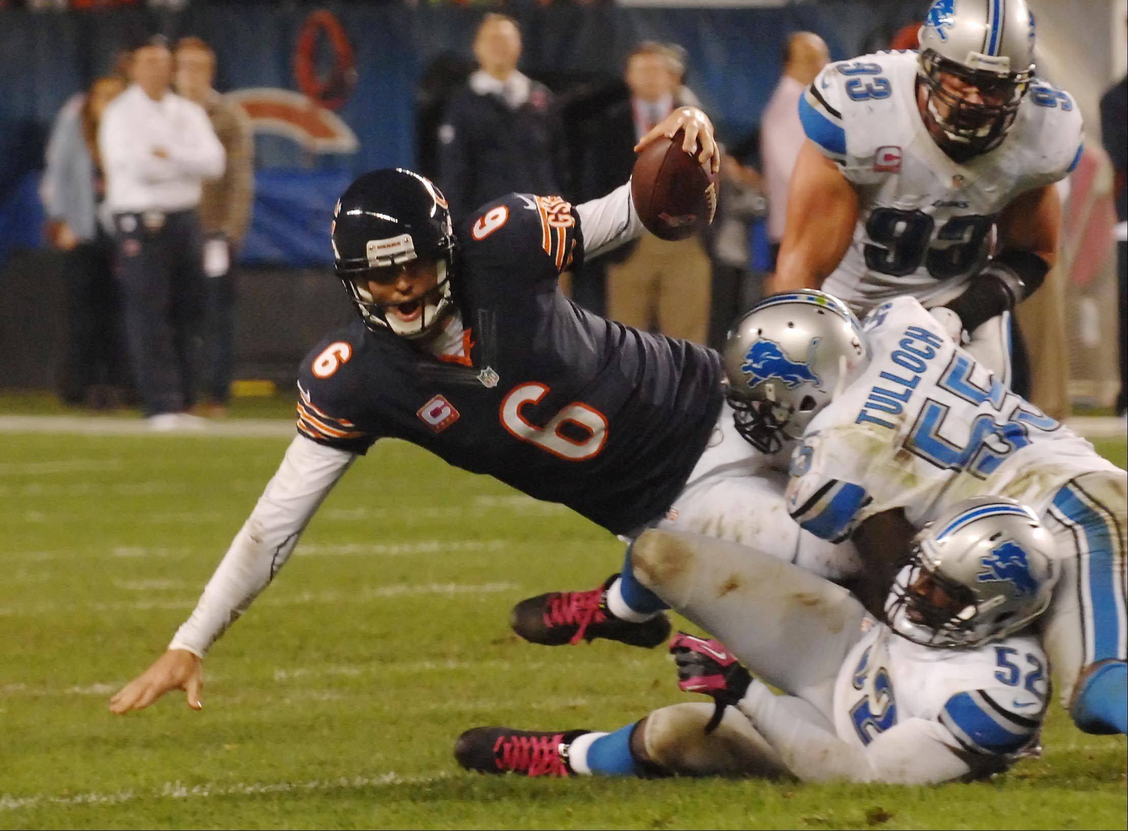Detroit Lions middle linebacker Stephen Tulloch and outside linebacker Justin Durant sack Chicago Bears quarterback Jay Cutler in the second quarter at Soldier Field Monday night, forcing a fourth-down field goal attempt that was blocked.