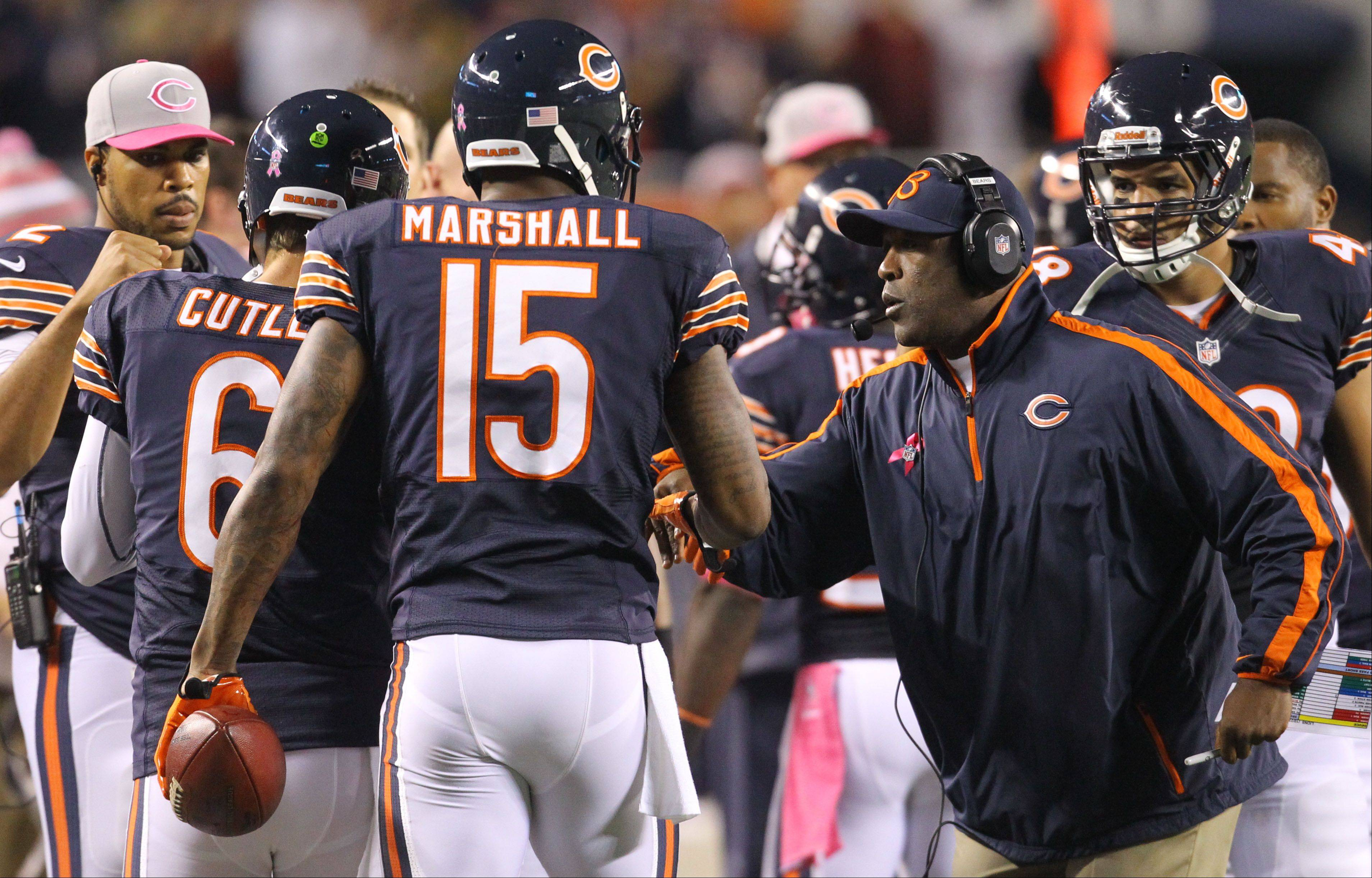 Chicago Bears coach Lovie Smith congratulates Jay Cutler and Brandon Marshall after they connected for a first half touchdown .