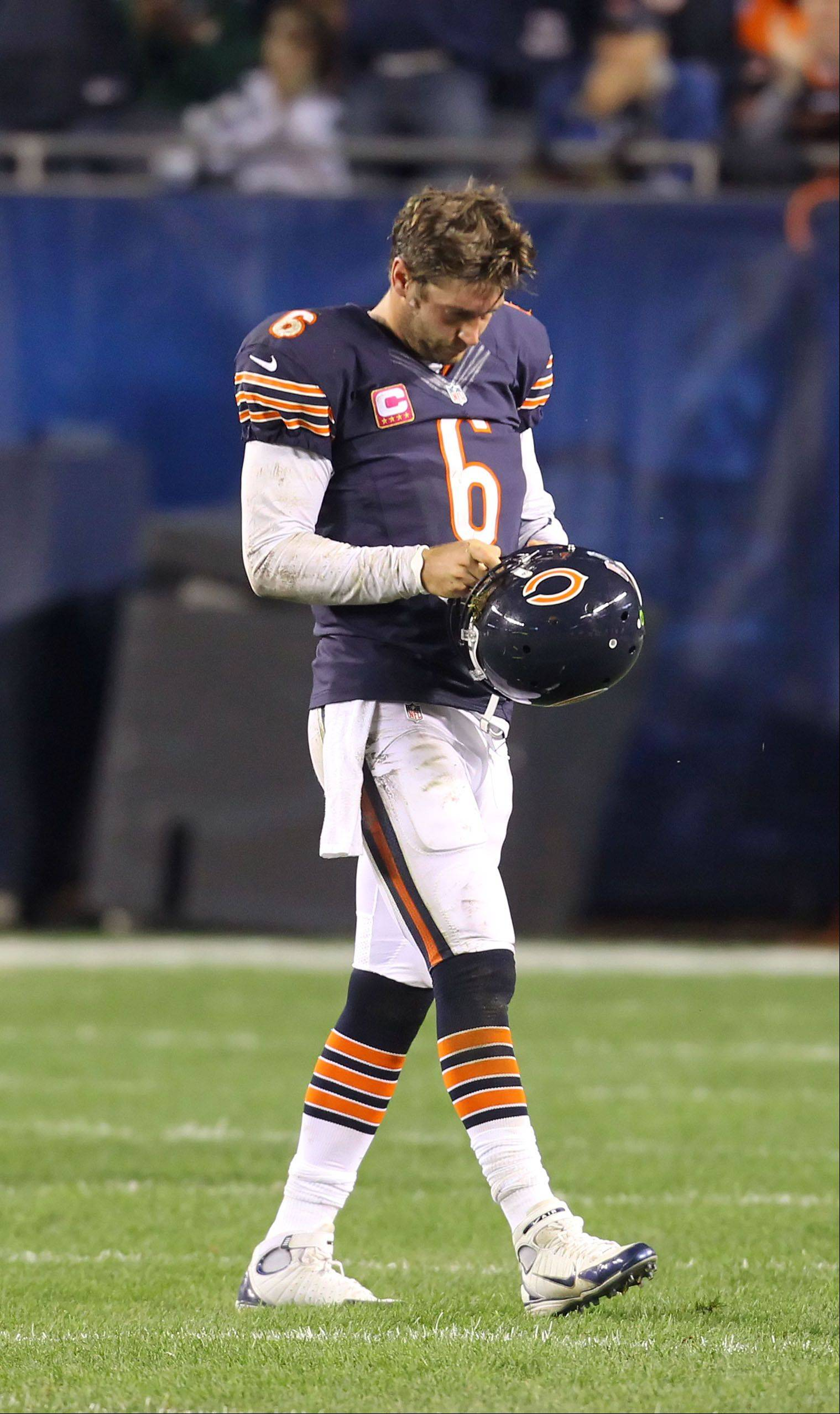 Chicago Bears quarterback Jay Cutler walks off the field after getting injured by Detroit Lions defensive tackle Ndamukong Suh.