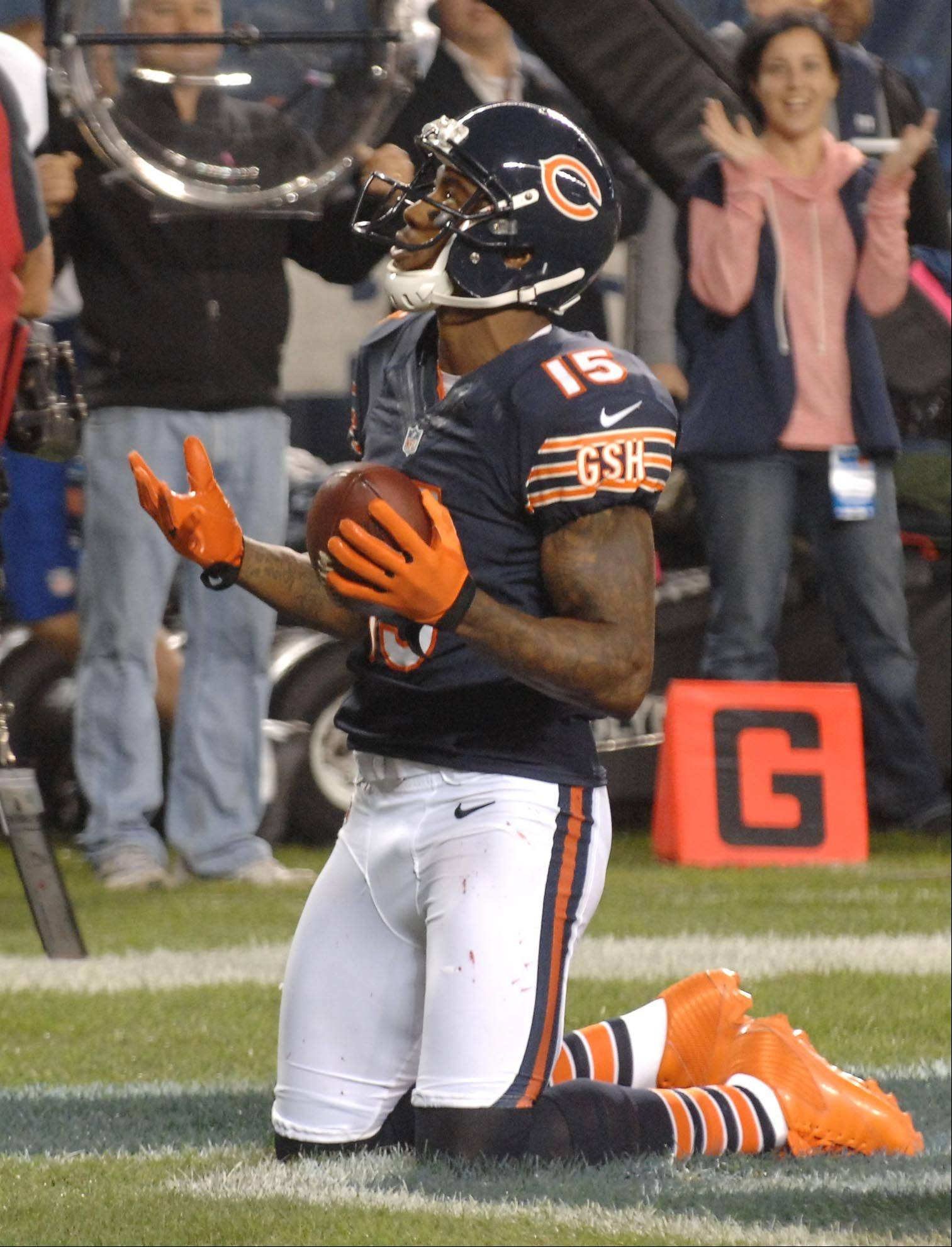 Chicago Bears wide receiver Brandon Marshall reacts after scoring in the first quarter.