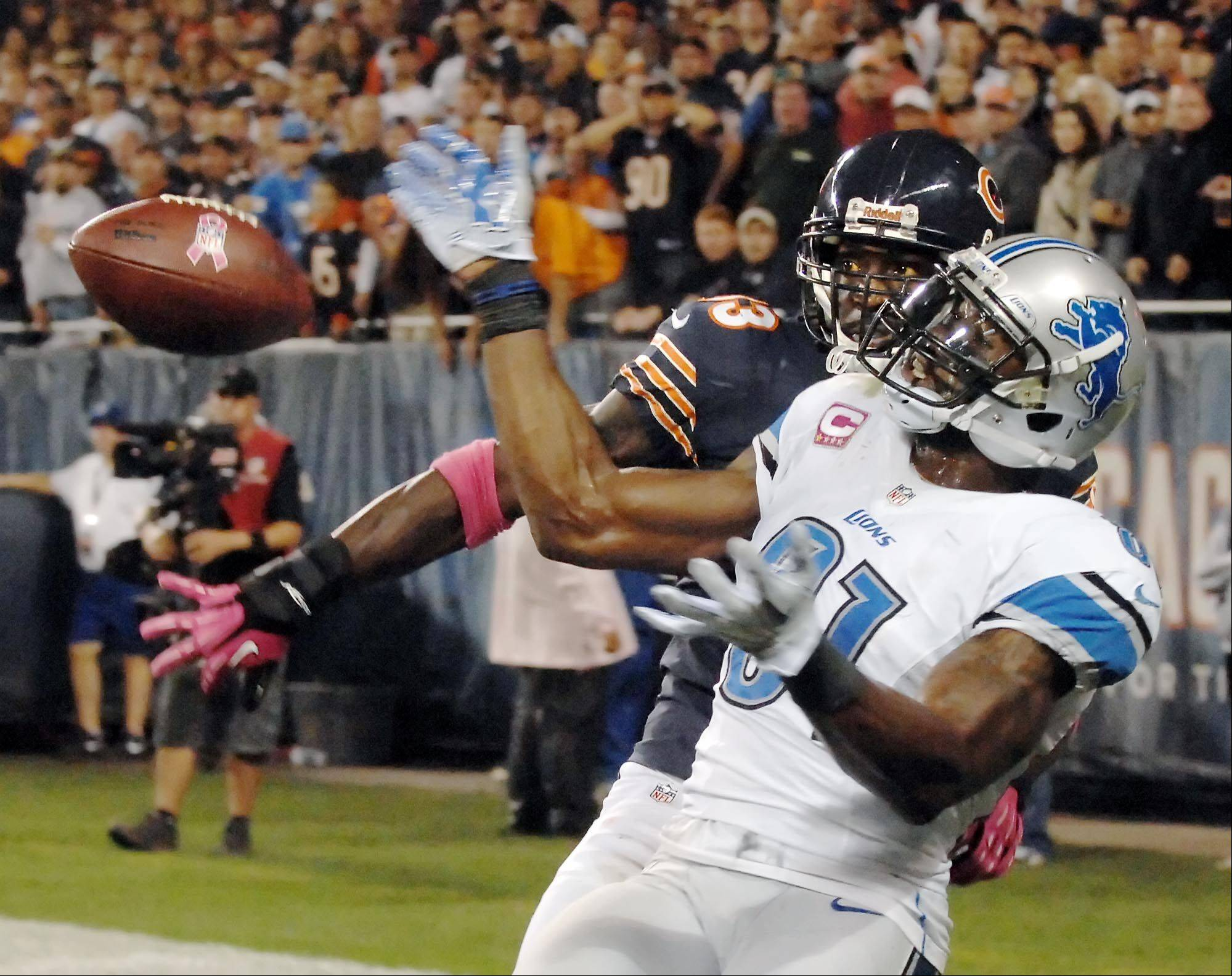 Chicago Bears cornerback Charles Tillman knocks the ball away form Detroit Lions wide receiver Calvin Johnson in the end zone late in the game.