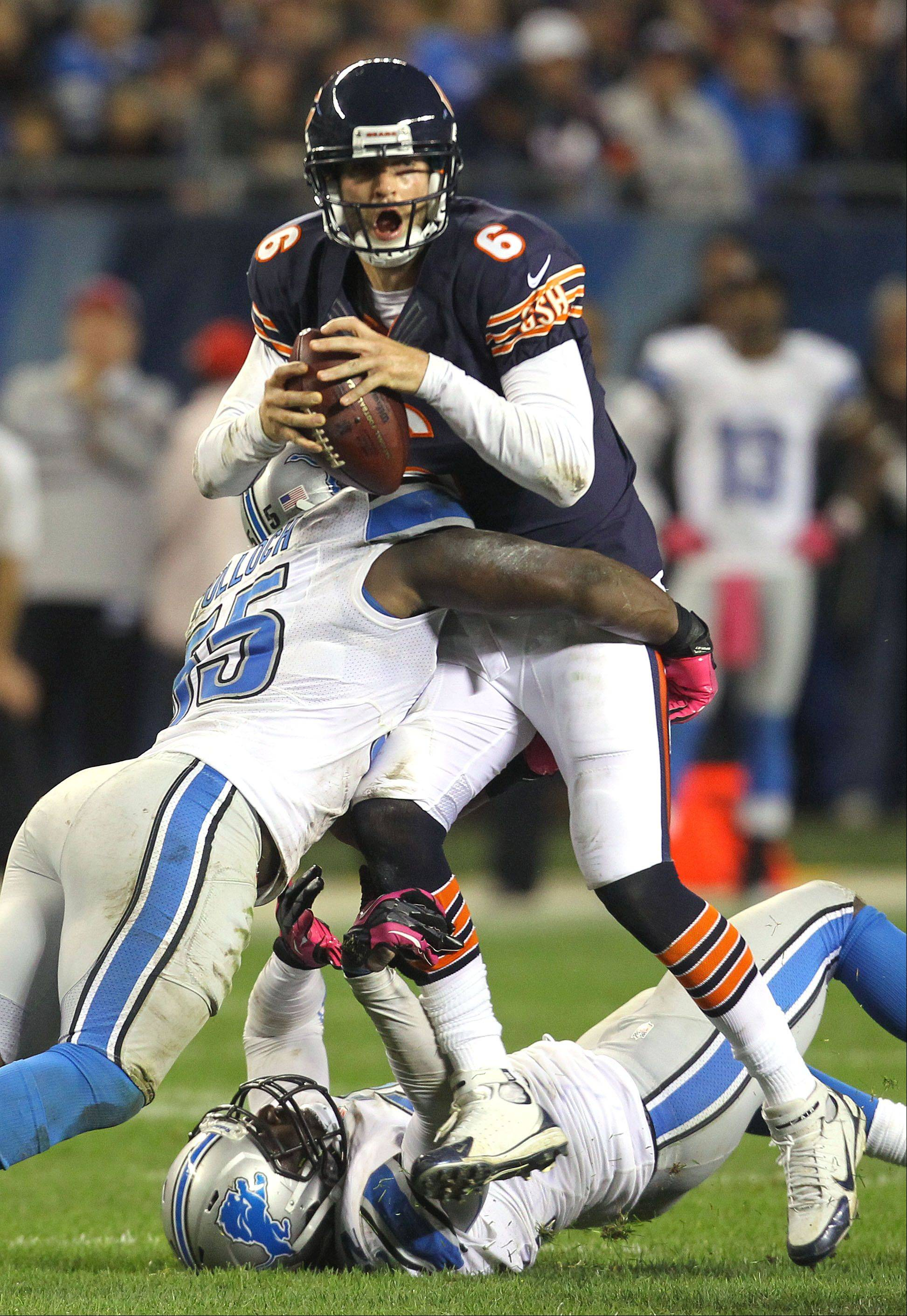 Chicago Bears quarterback Jay Cutler is sacked by Detroit Lions middle linebacker Stephen Tulloch .