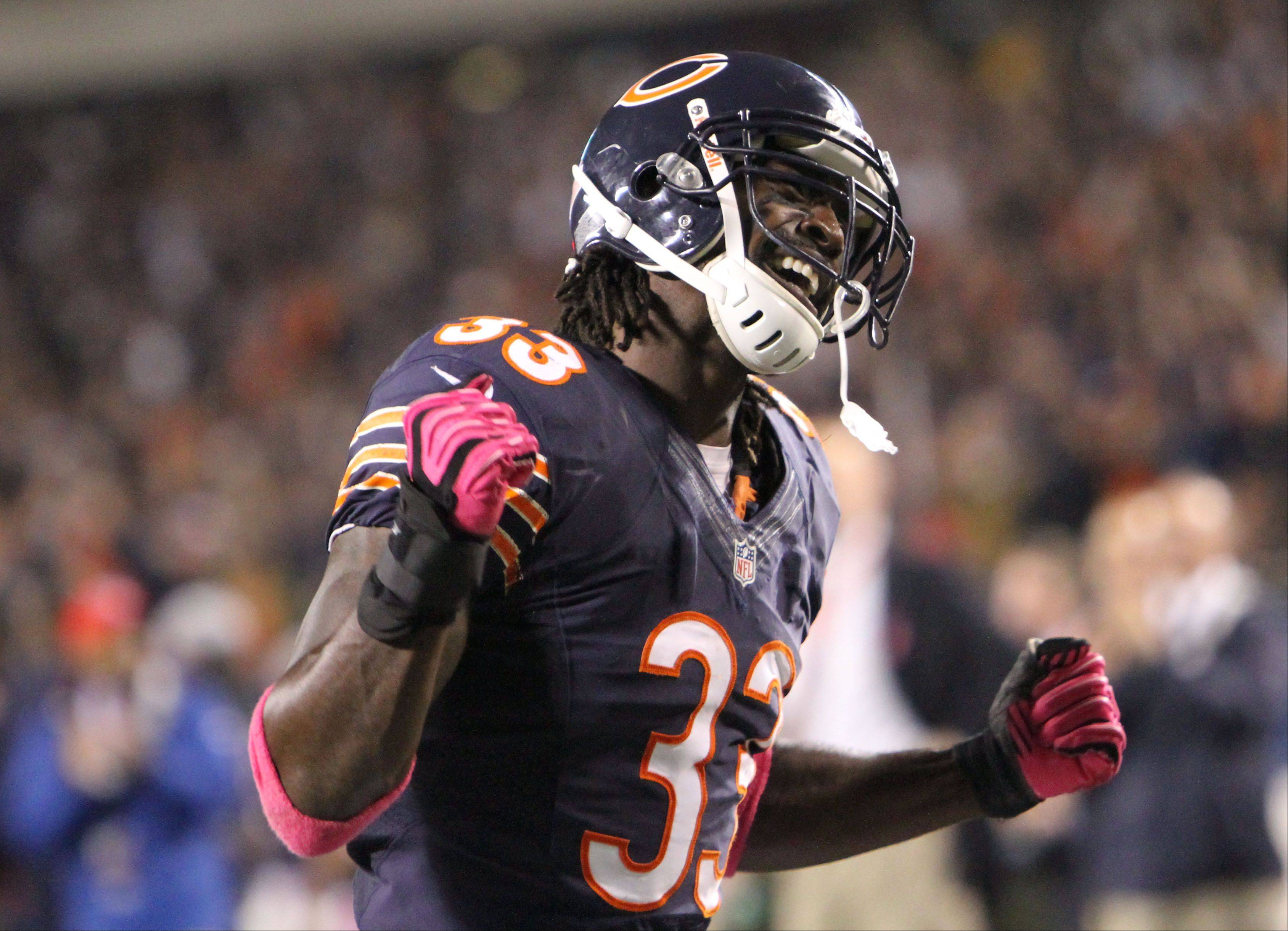Chicago Bears cornerback Charles Tillman celebrates after Chicago Bears middle linebacker Brian Urlacher recovered a fumble in the third quarter.