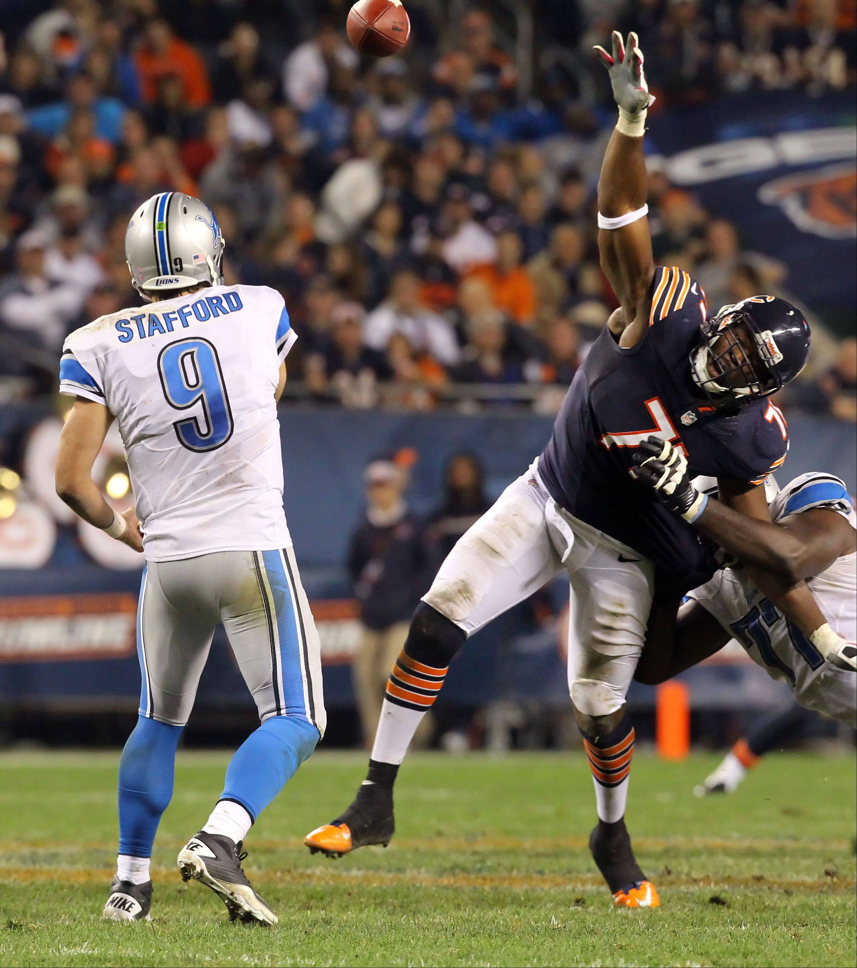 Chicago Bears defensive end Israel Idonije pressures Detroit Lions quarterback Matthew Stafford .