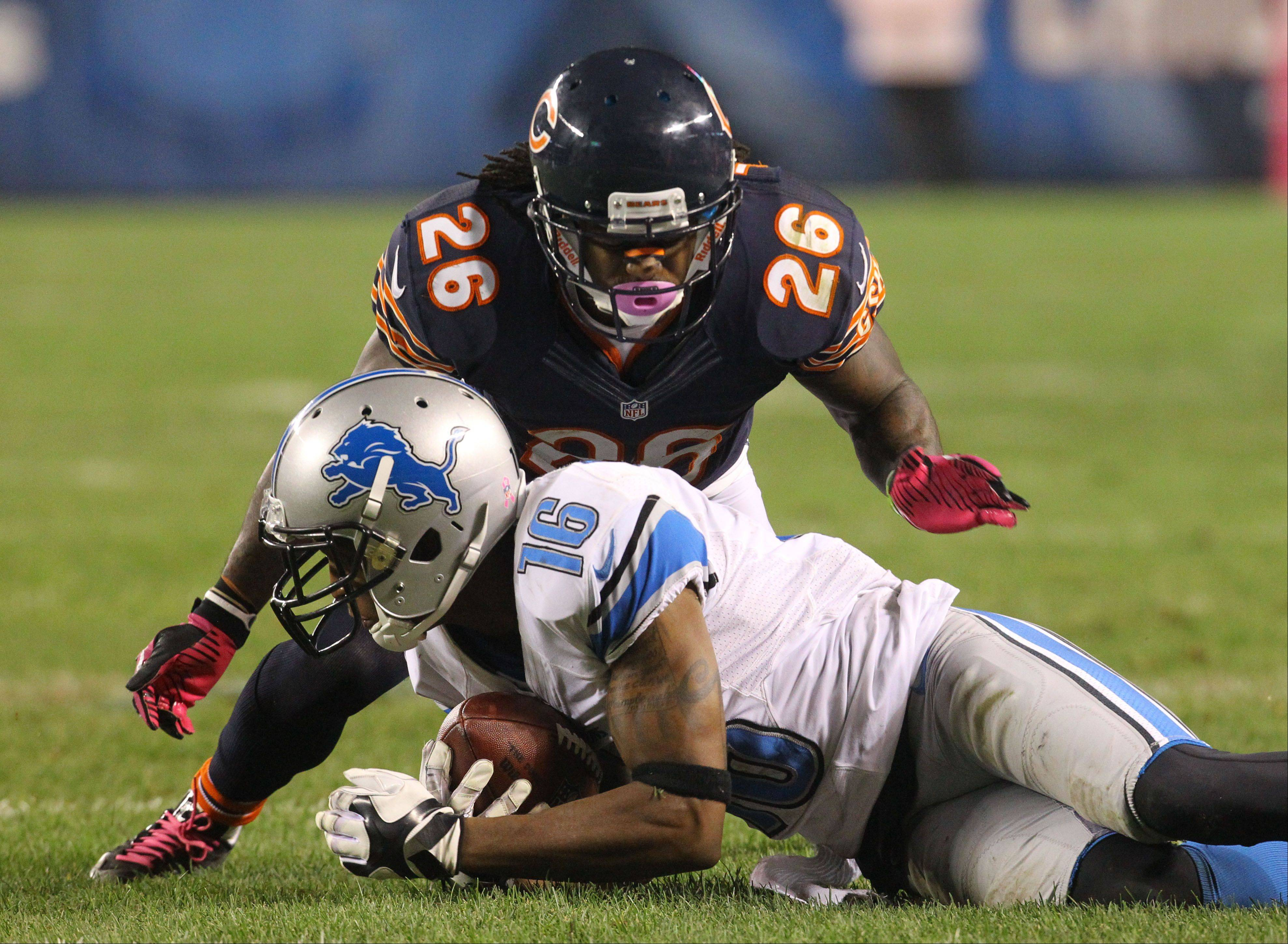 Chicago Bears cornerback Tim Jennings tackles Detroit Lions wide receiver Titus Young.