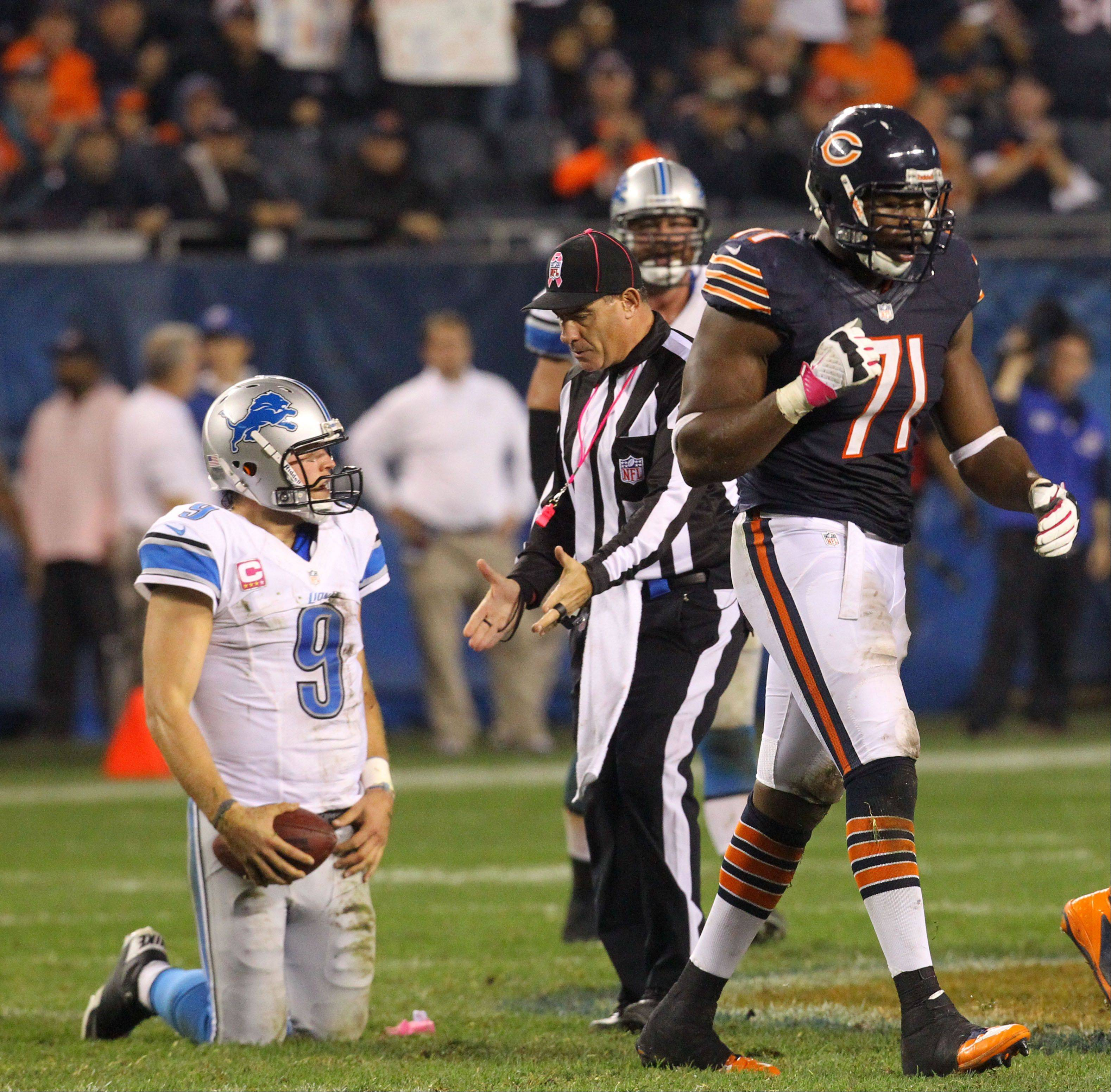 Chicago Bears defensive end Israel Idonije celebrates after sacking Detroit Lions quarterback Matthew Stafford.