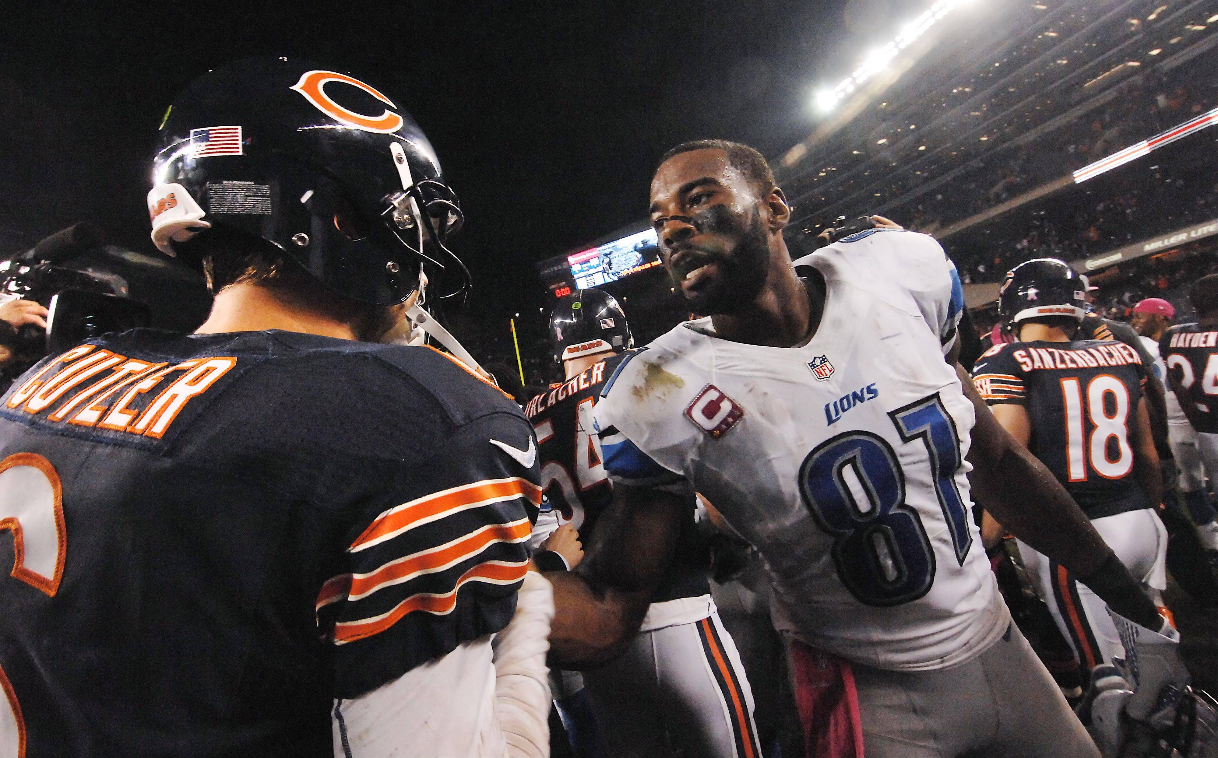 Detroit Lions wide receiver Calvin Johnson speaks with Chicago Bears quarterback Jay Cutler after the game.