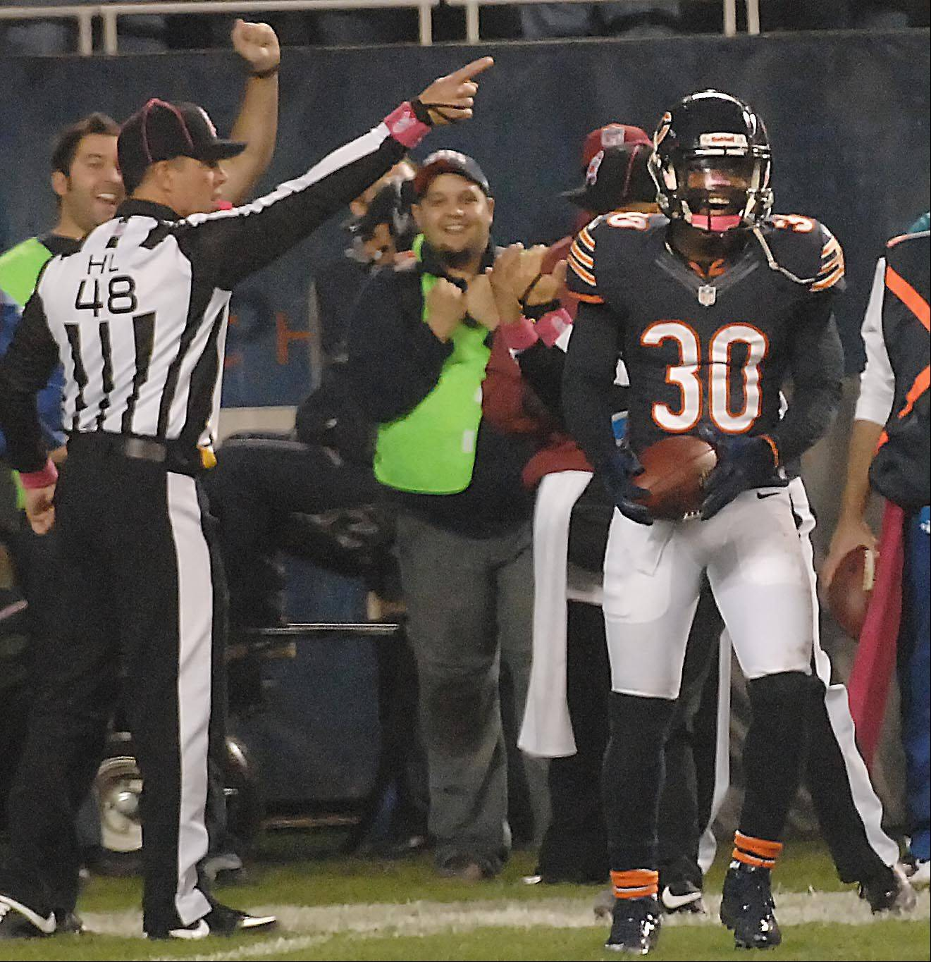 Chicago Bears cornerback D.J. Moore laughs as the referee signals interception late in the game .