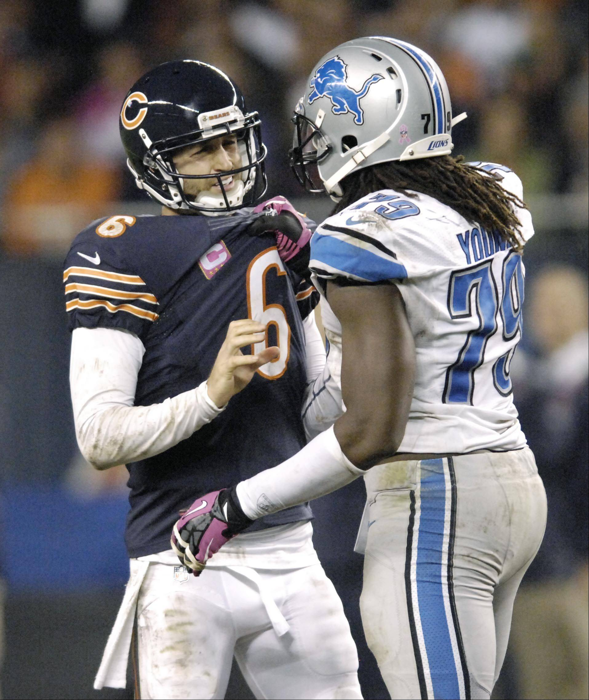 Detroit Lions defensive end Willie Young and Chicago Bears quarterback Jay Cutler shove each other late in the game.