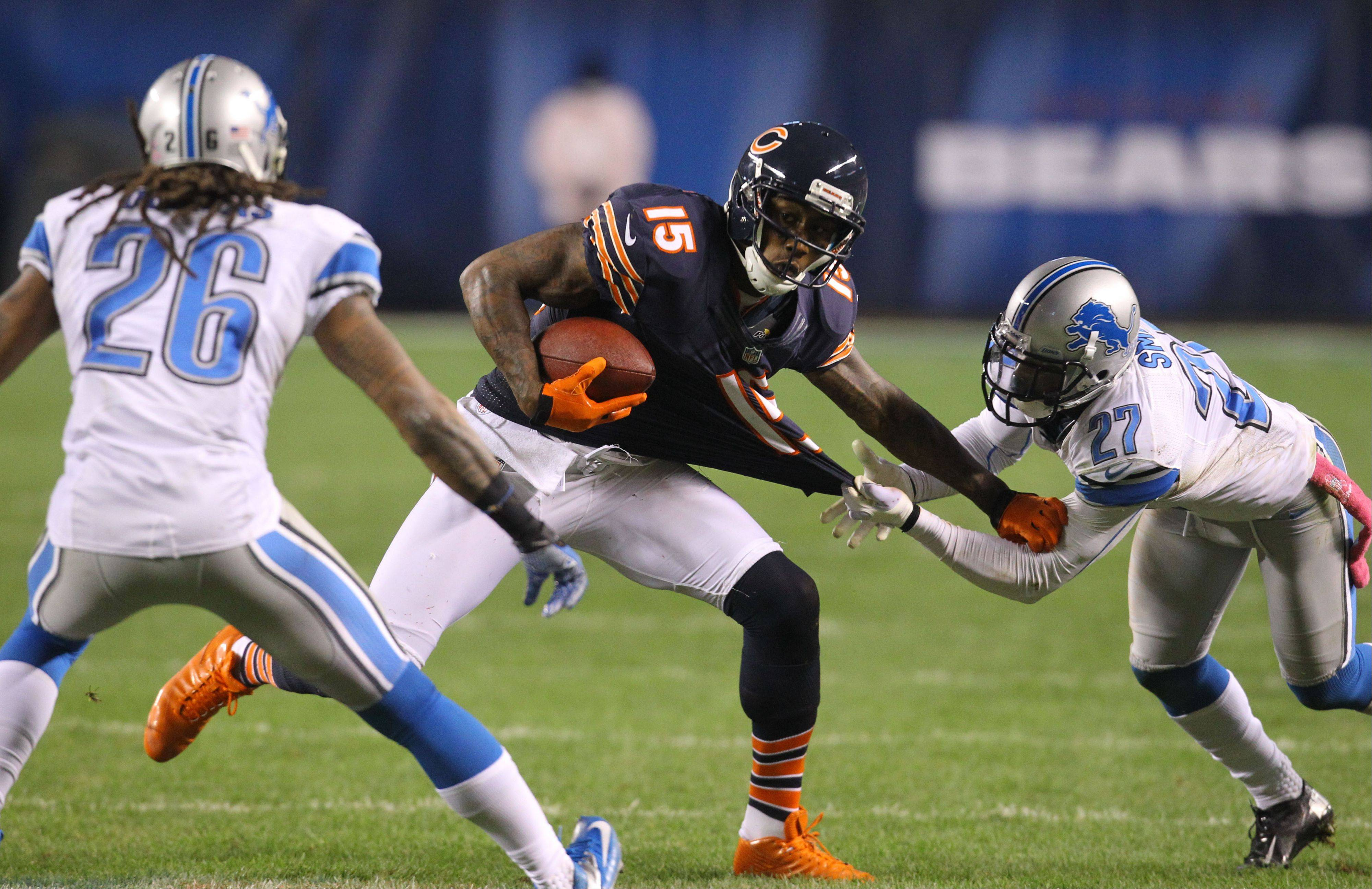 Chicago Bears wide receiver Brandon Marshall tries to get around Detroit Lions free safety Louis Delmas during their game Monday night at Soldier Field in Chicago.
