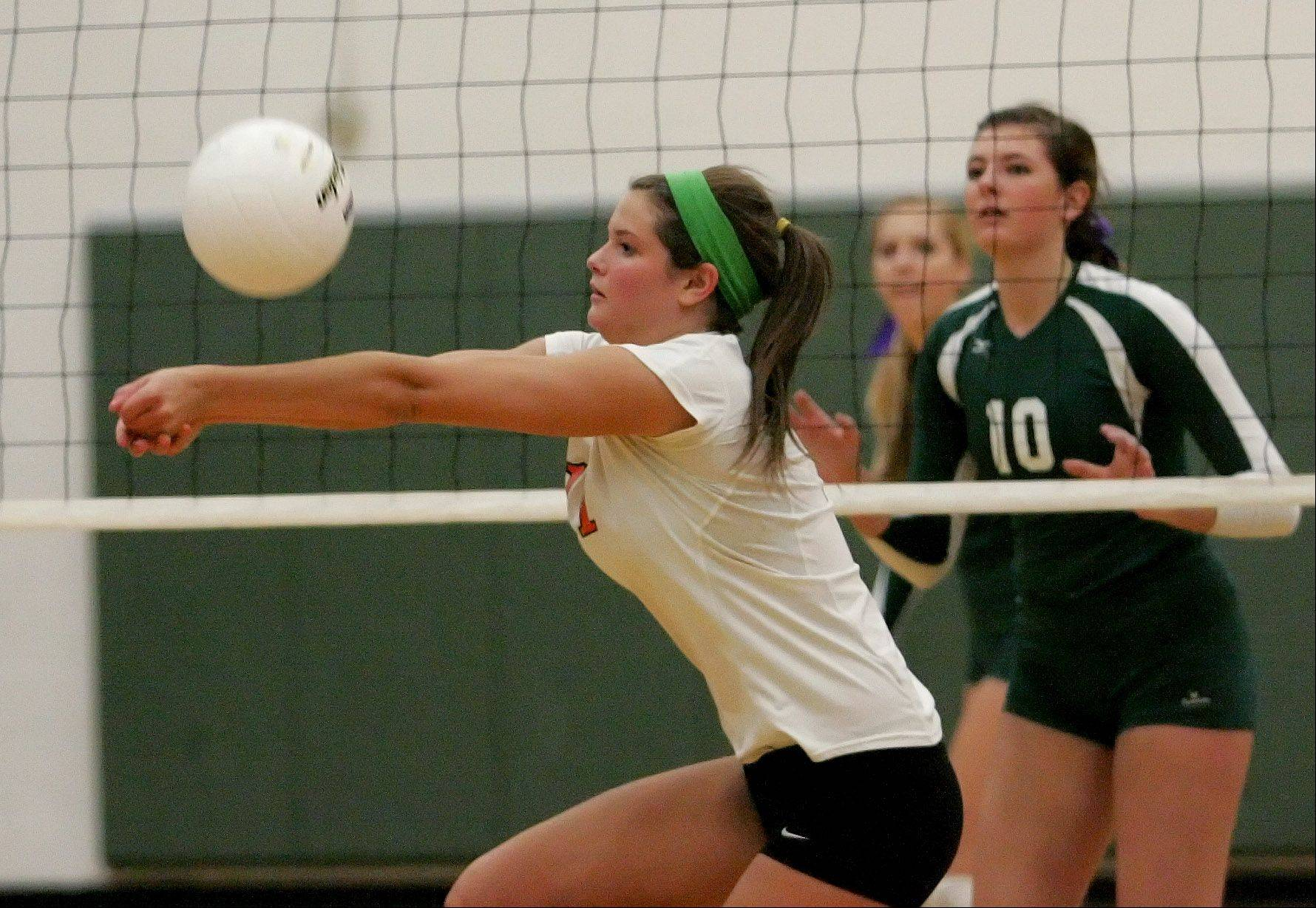 St. Charles East's Erienne Barry returns a ball during Monday's volleyball game against Waubonsie Valley.