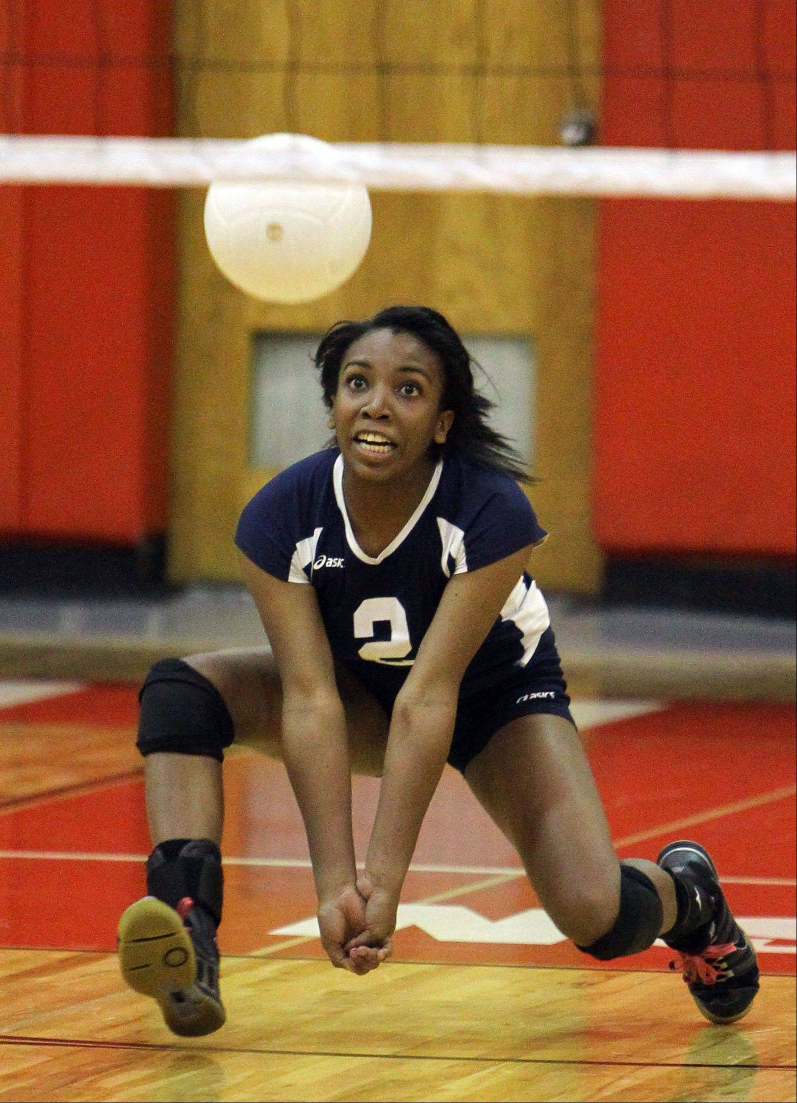 Round Lake's Destiny Brown tries digs out a serve during Monday's game at Mundelein High School.