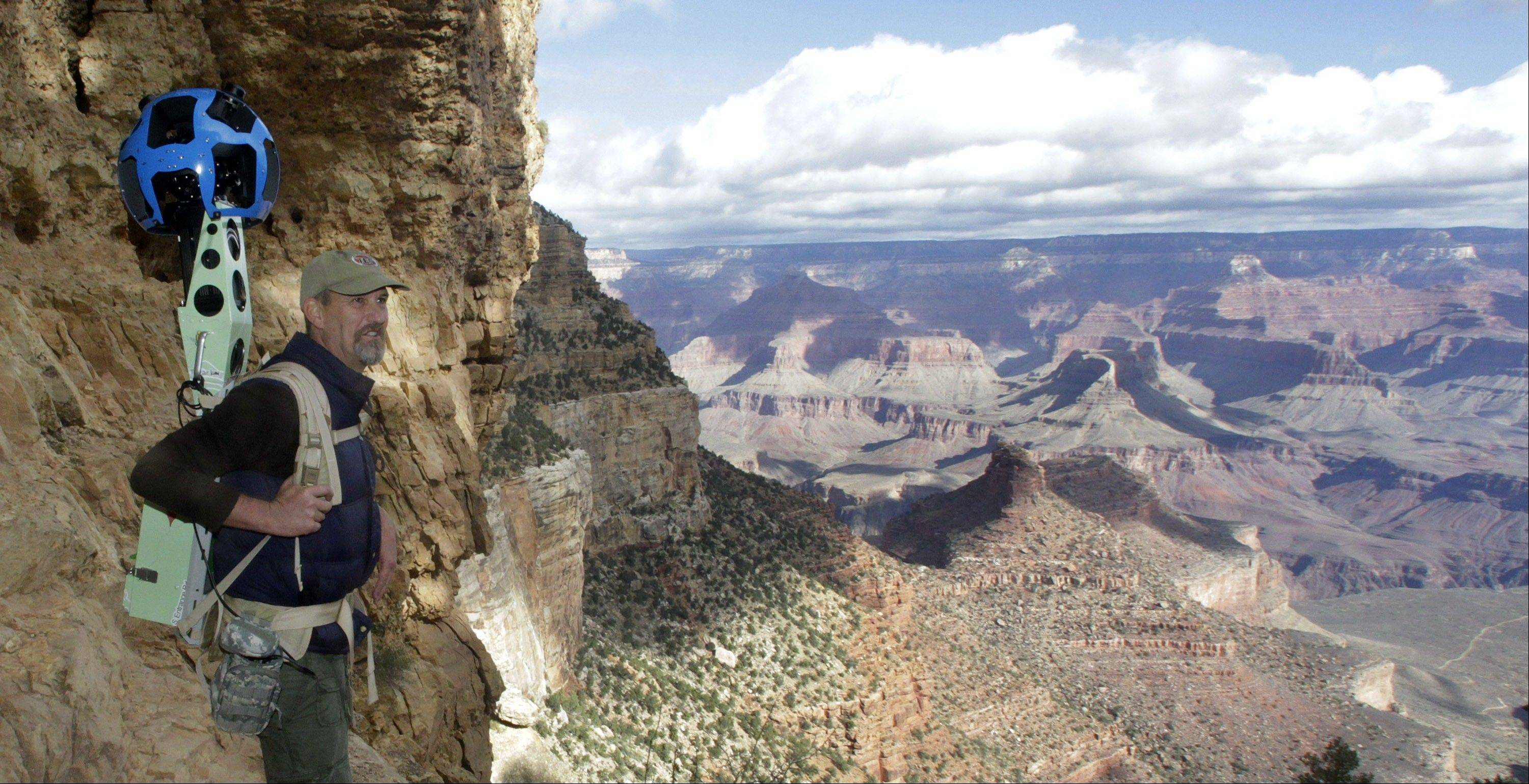 Google operations manager Steve Silverman stands along the canyon wall wearing the Trekker during a demonstration along the Bright Angel Trail at the South Rim of the Grand Canyon National Park in Arizona. The search engine giant is using the nearly 40-pound, backpack-sized camera unit to showcase the Grand Canyon's most popular hiking trails on the South Rim and other off-road sites. It's about 4 feet in height when set on the ground, and when worn, the camera system extends 2 feet above the operator's shoulders.