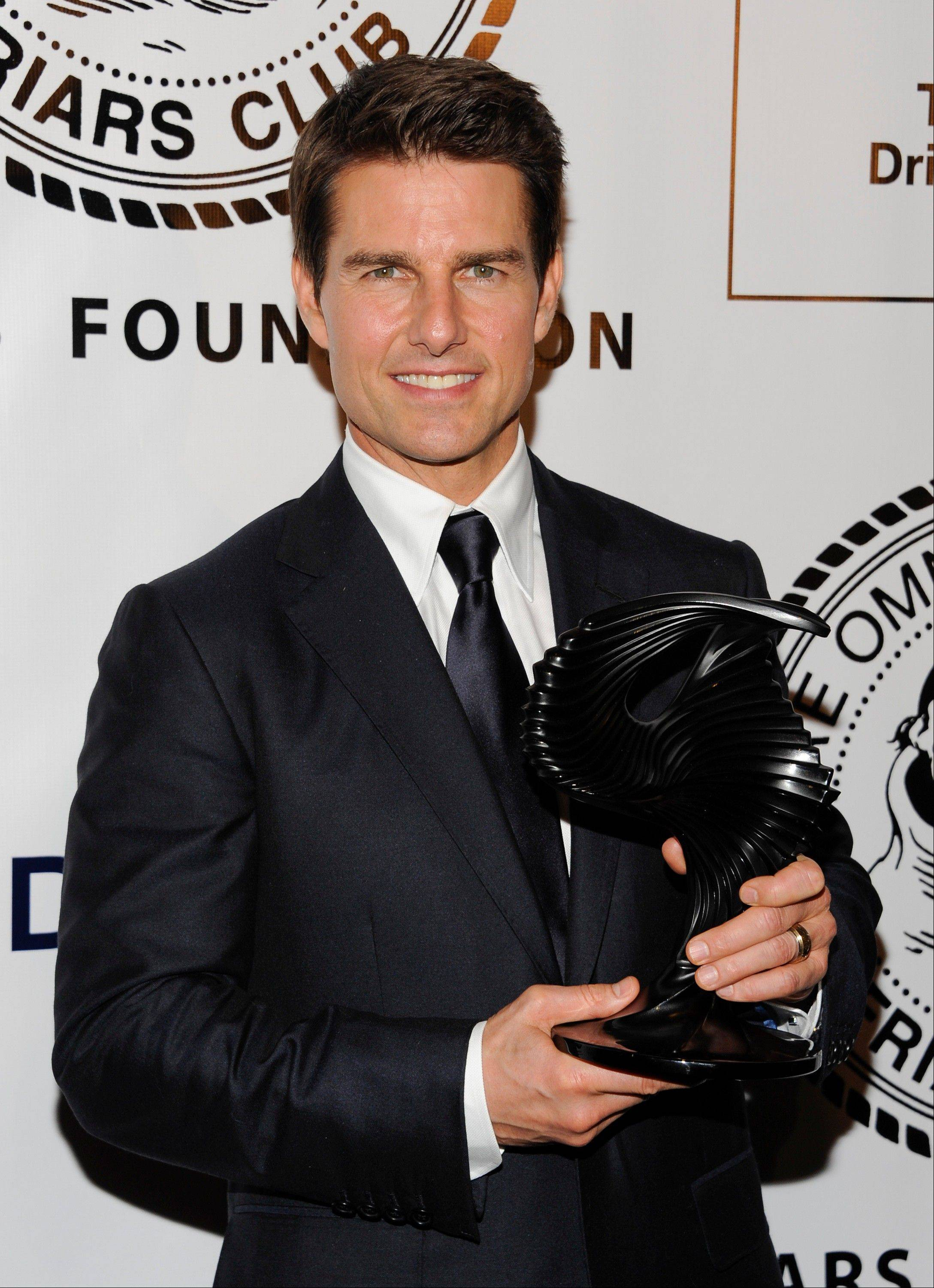 Tom Cruise he has filed a $50 million defamation lawsuit against the publishers of Life & Style magazine for articles that said the actor has abandoned his 6-year-old daughter, Suri.