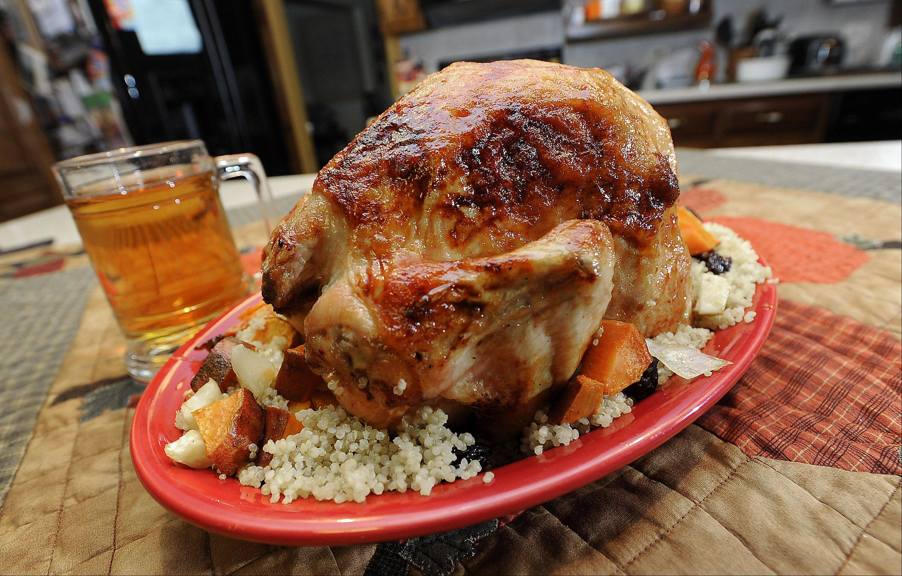 Michelle Abraham cooked a whole chicken beer-can style and served roasted celeriac and quinoa, dried plums on the side.