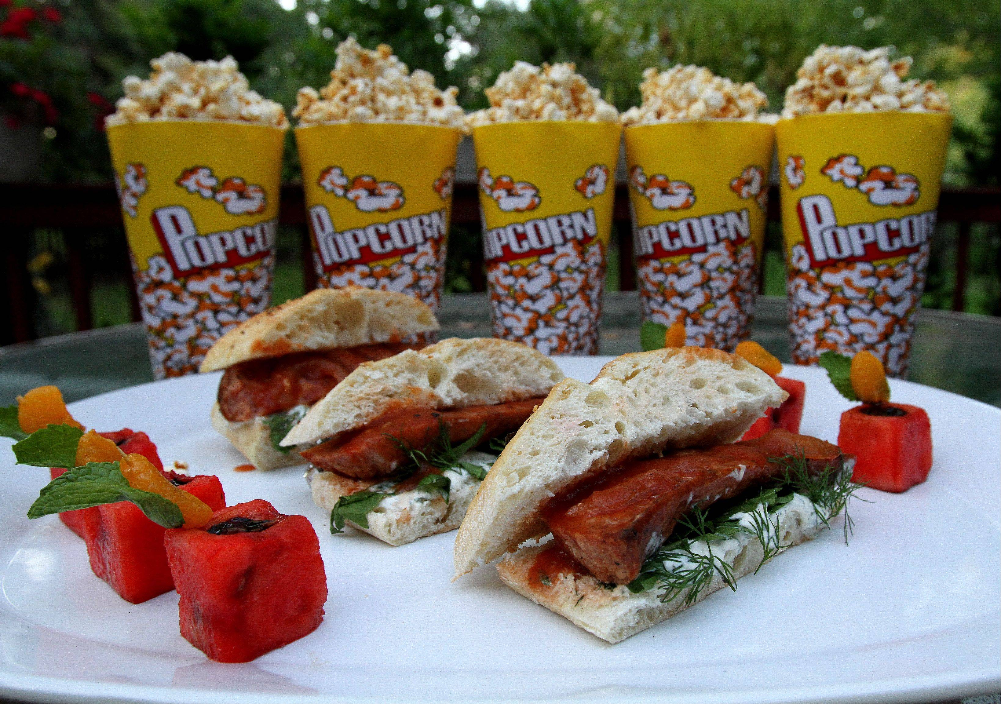 Terri Edmunds of Naperville impressed the judges with her Kielbassa Blitz Sandwiches, Sweet & Fiery Touchdown Popcorn and Watermelon Field Goal Bites during the tailgate challenge.