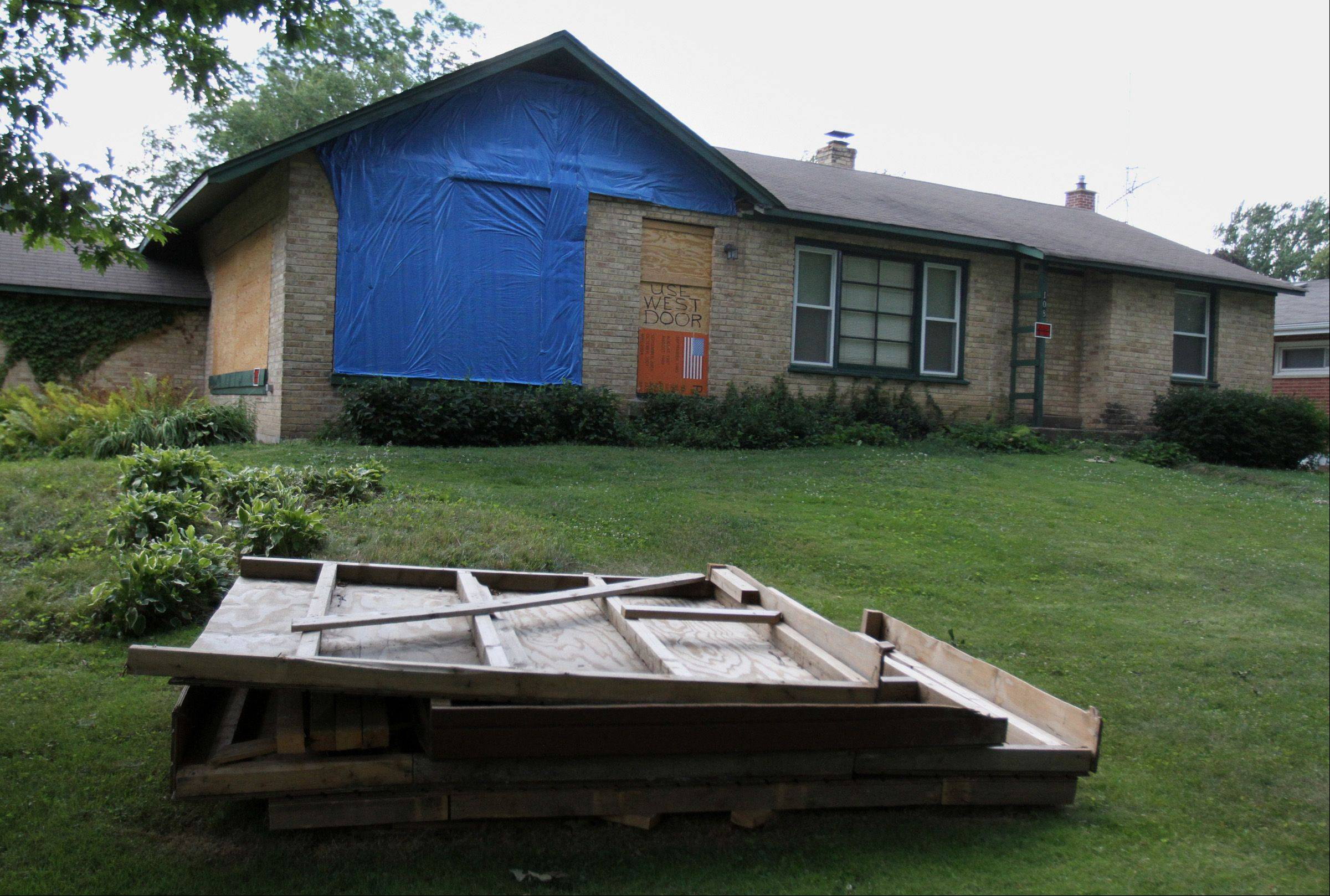 Former Palatine councilman Warren Kostka�s house on Forest Avenue in Palatine. A Cook County judge Wednesday gave Kostka 30 days to remove a tarp and boards from his house and another 30 to come into full compliance with village codes.