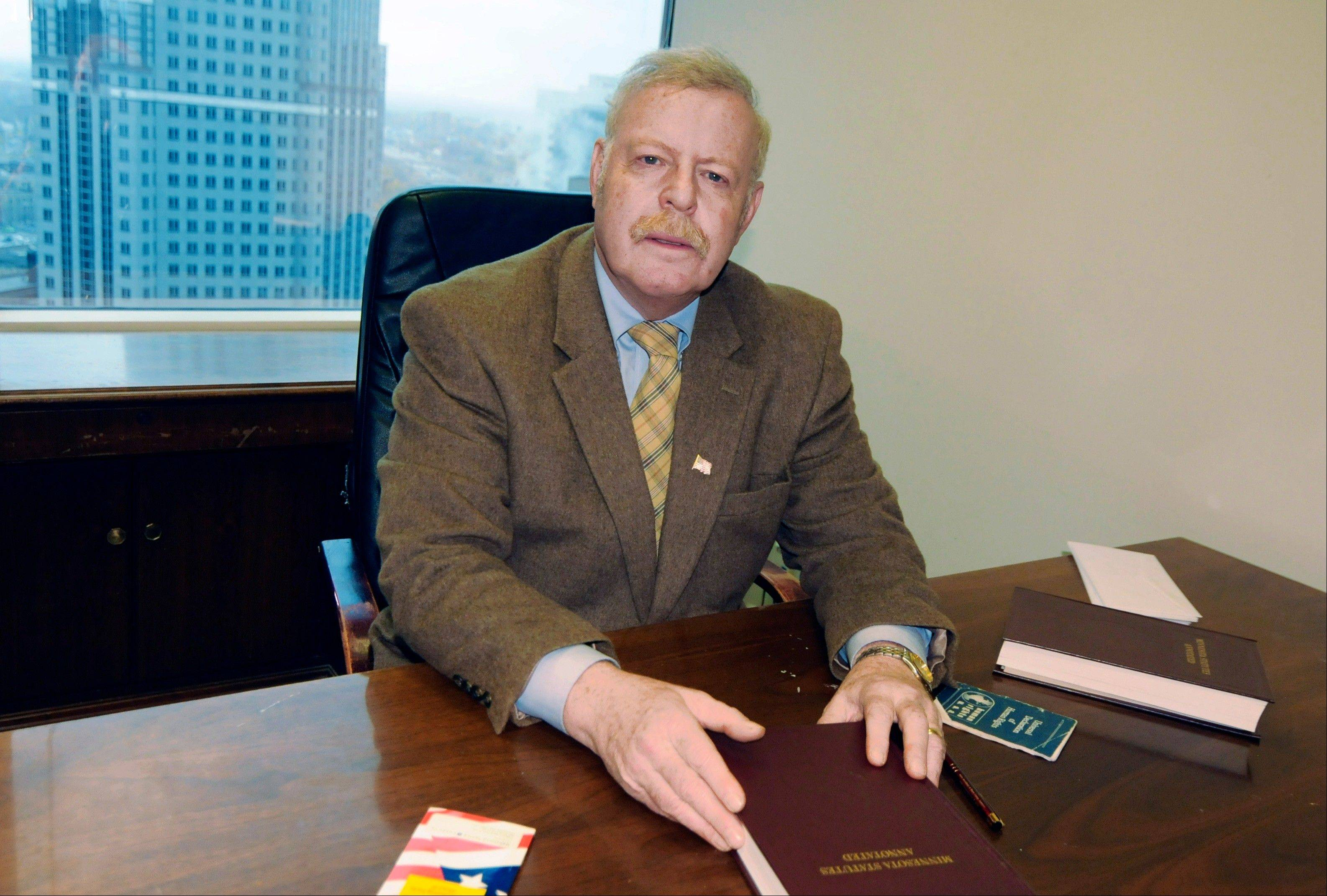 Marshall Tanick, attorney for Dr. David McKee, poses for photos in his Minneapolis office on Wednesday. McKee sued a patient's son for defamation after critical remarks about him were posted on rate-your-doctor websites.