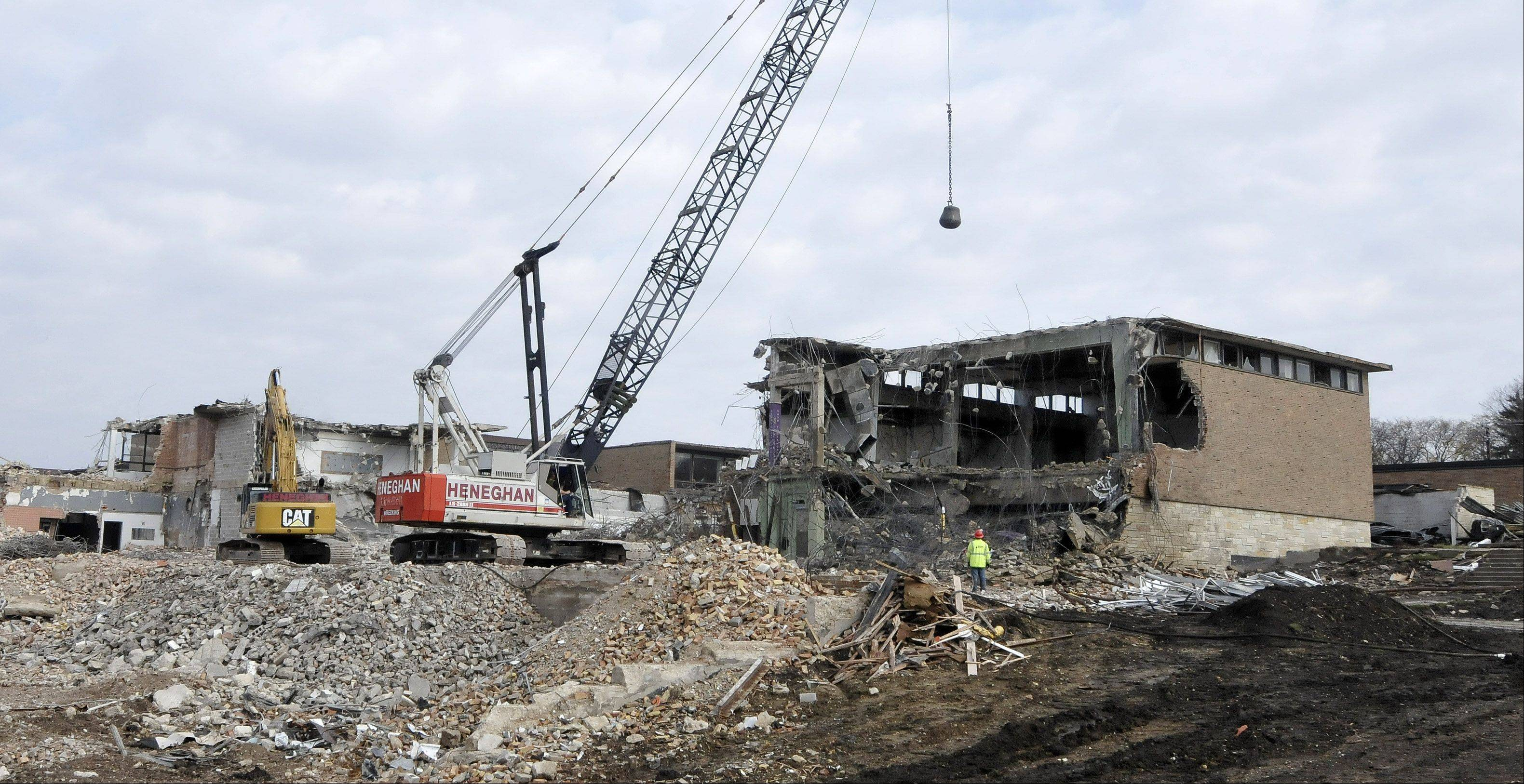 Demolition continues Wednesday at the former Hubble Middle School. Wheaton Warrenville Unit District 200 officials plan to sell keepsake bricks from the site.