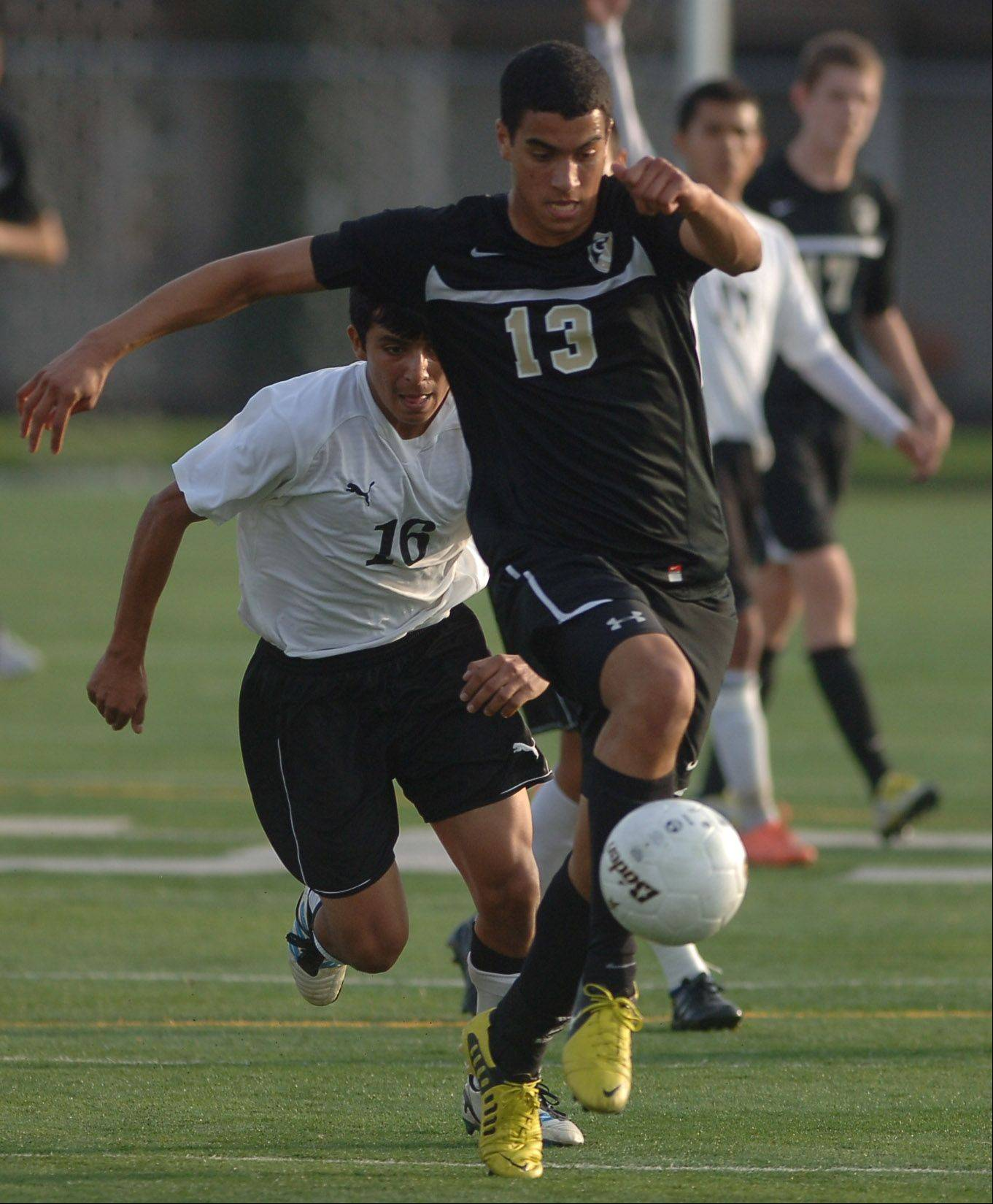 Grayslake North�s Arnaud Laroche-Bataille (13) takes control of the ball in front of Harvard�s Isaih Solis during Wednesday�s Class 2A soccer sectional semifinal game at Grayslake Central.