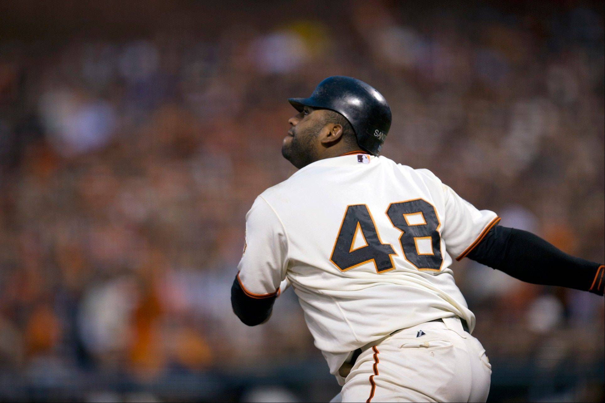 San Francisco Giants third baseman Pablo Sandoval watches the flight of his second home run against the Detroit Tigers Wednesday during Game 1 of the World Series in San Francisco.