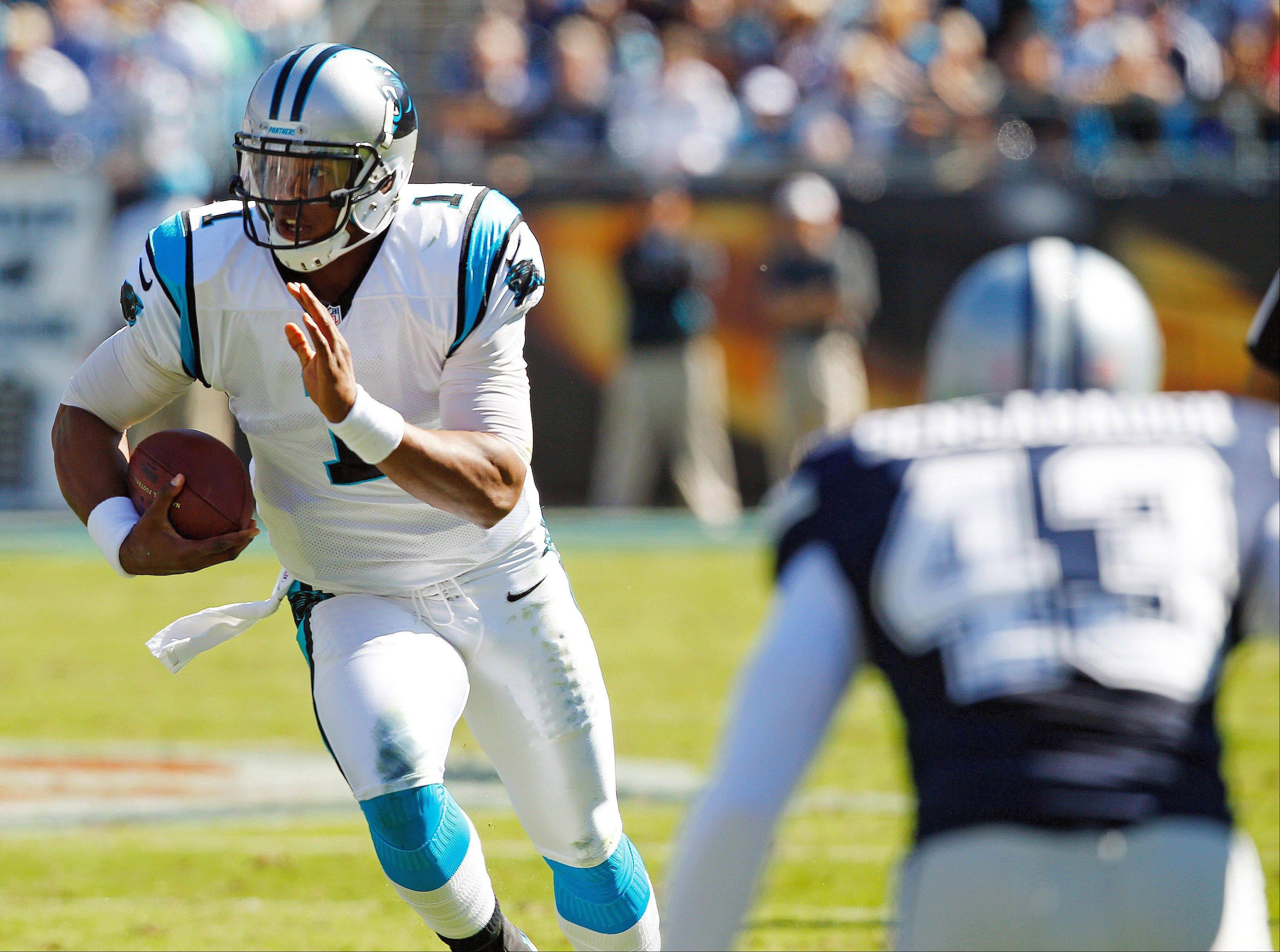 Panthers quarterback Cam Newton completed 27 passes for 374 yards and also ran for 2 touchdowns last season in a loss to the Bears at Soldier Field.