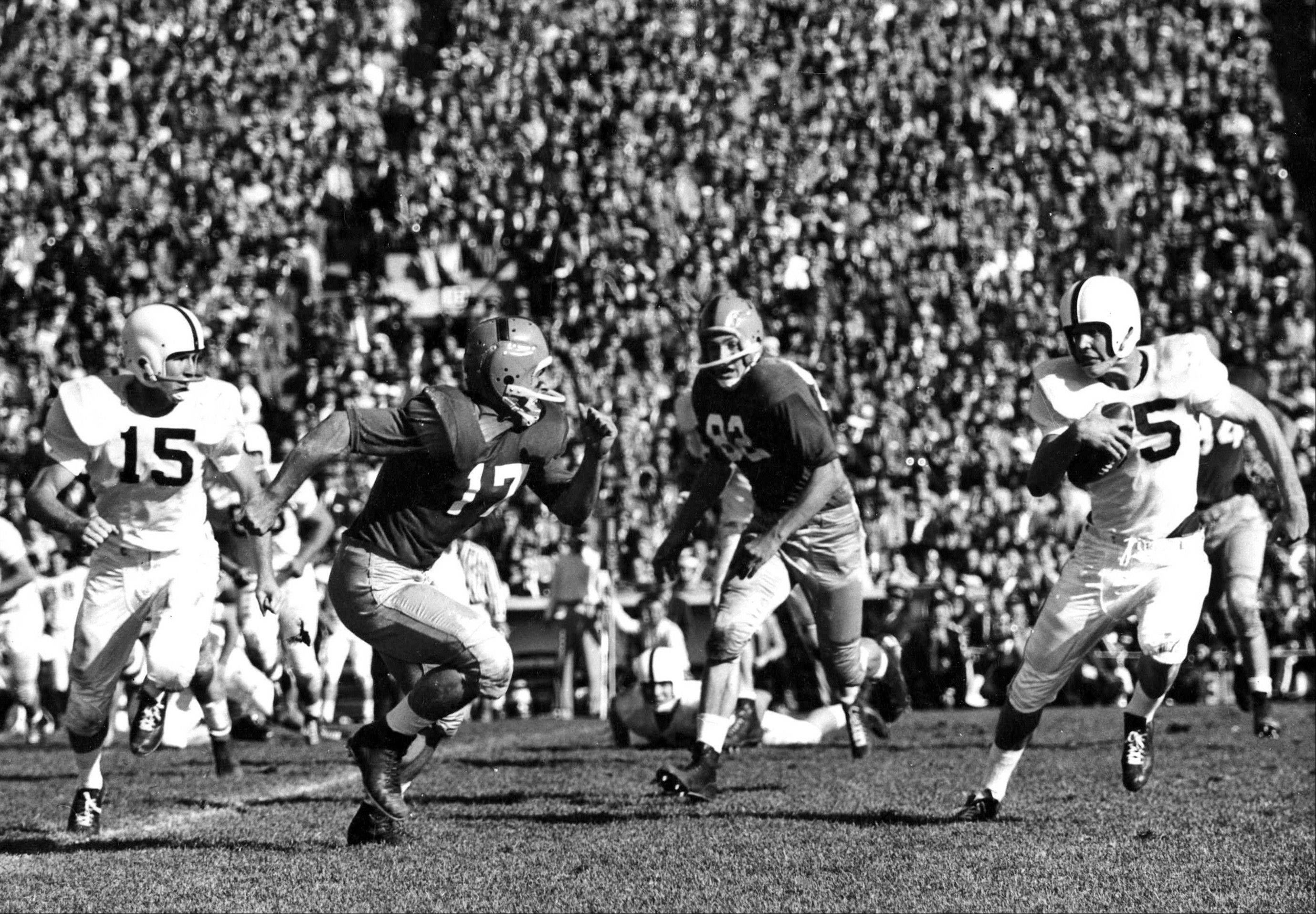 Oklahoma's Clendon Thomas, right returns an interception as Notre Dame's Jim Morse chases during a game in South Bend, Ind. Notre Dame has had some great victories in its 125 years of playing college football, yet none was as improbable as the 7-0 victory at second-ranked Oklahoma in 1957. That victory ended the Sooners' NCAA-record winning streak at 47 games and came just a season after the Sooners beat the Irish 40-0 in South Bend, still the most lopsided home loss in Notre Dame history.