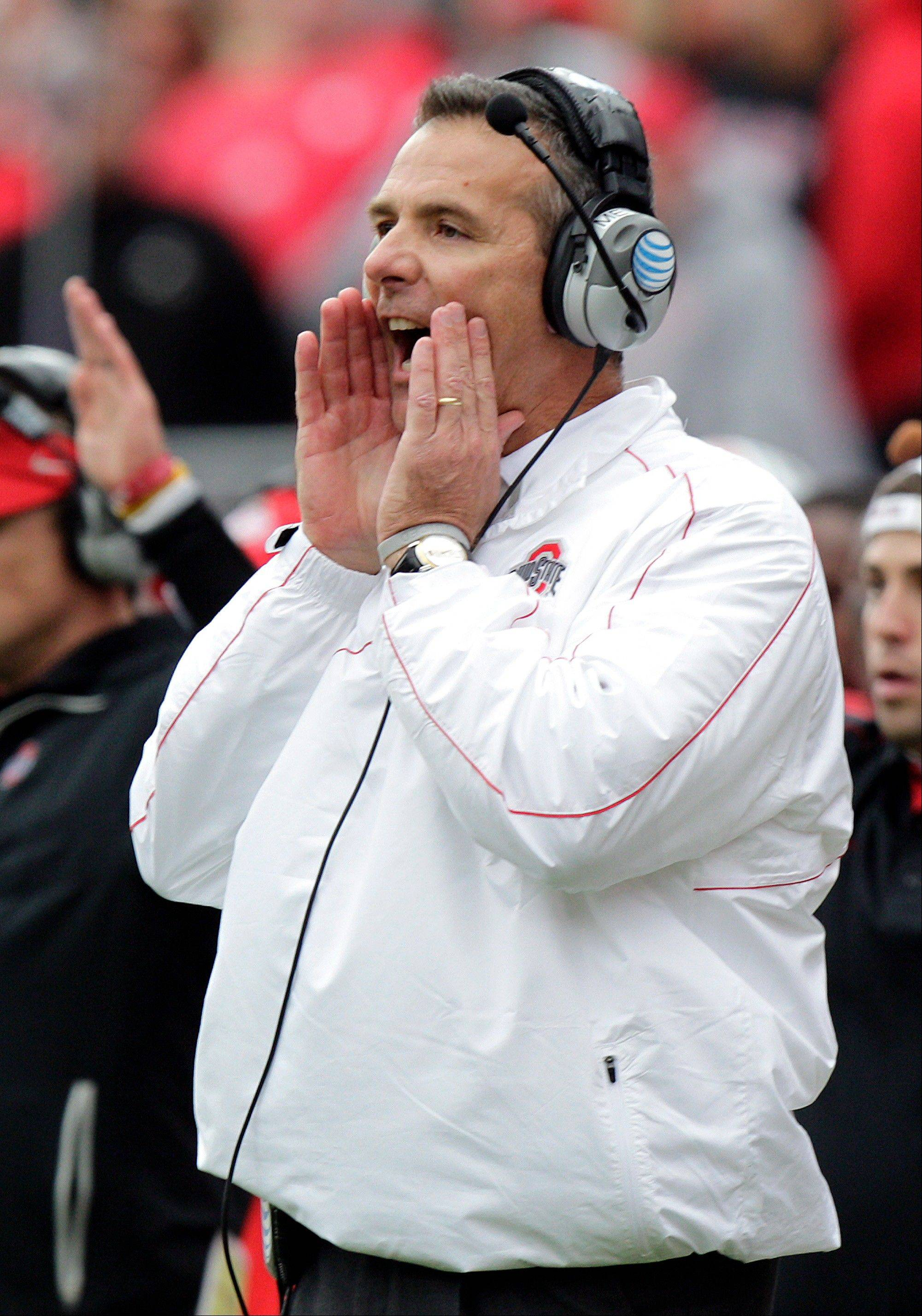 Ohio State head coach Urban Meyer coaches against Purdue Saturday in Columbus, Ohio. Ohio State defeated Purdue 29-22 in overtime.
