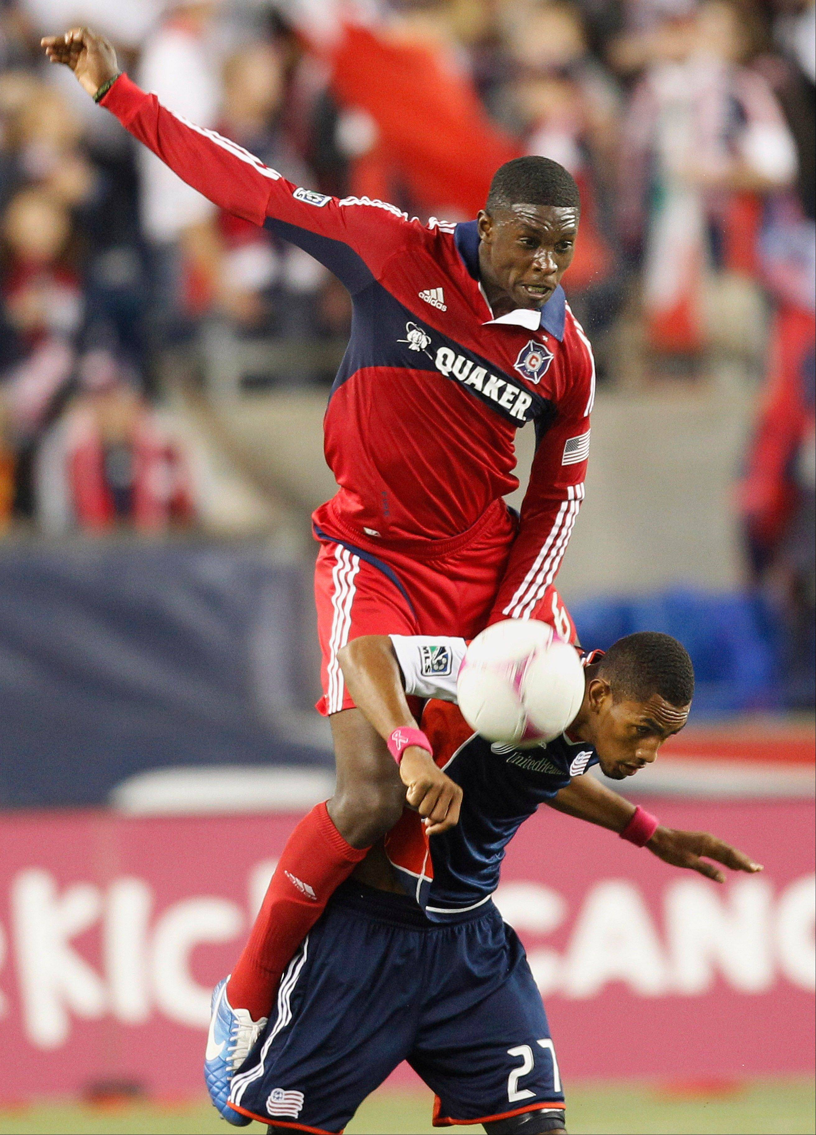 Chicago Fire defender Jalil Anibaba, top, leaps over New England Revolution�s Jerry Bengtson (27) in an attempt to get to the ball during their MLS match in Foxborough, Mass., Saturday. New England won 1-0.