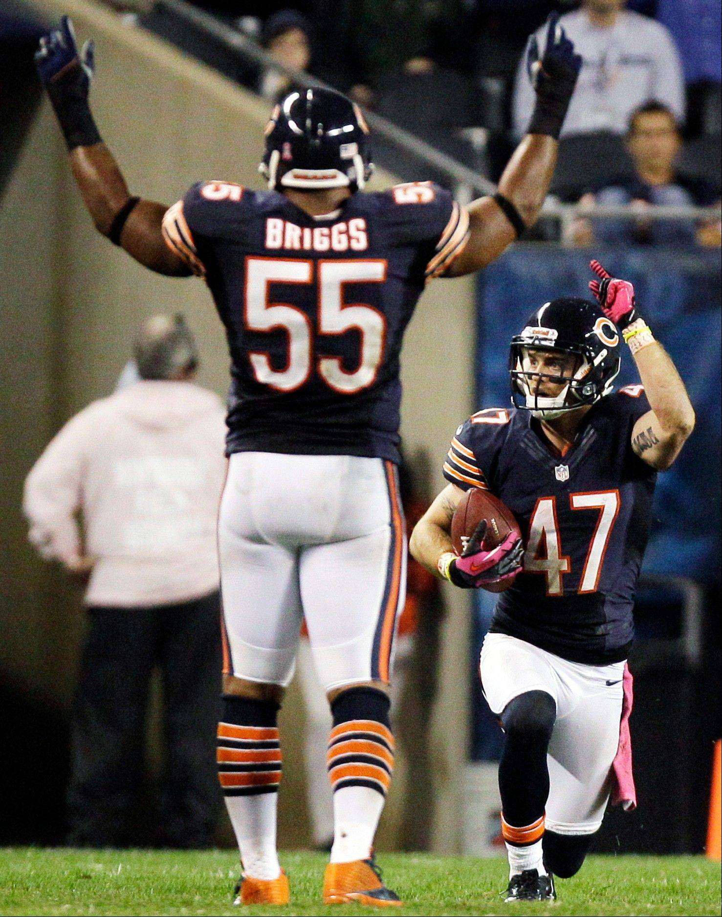 Bears safety Chris Conte celebrates with linebacker Lance Briggs (55) after intercepting a pass in the second half of Monday�s victory over Detroit.