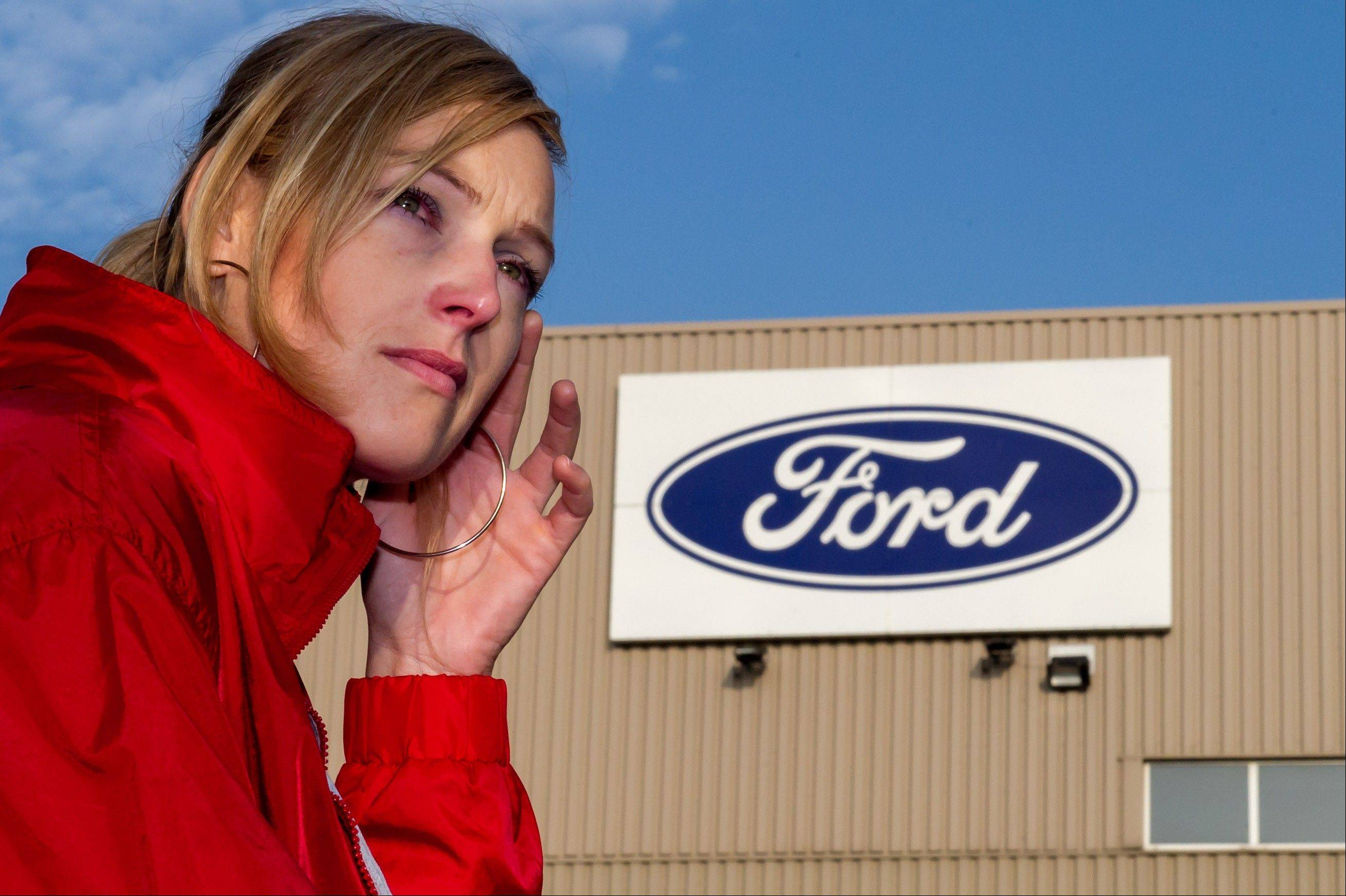 A Ford worker reacts after the European Ford management announced it would close the Ford plant in Genk, Belgium on Wednesday Oct. 24, 2012. A union leader says Ford has decided to close its factory in Genk, Belgium, at the end of 2014 in a move that will result in 4,500 direct job losses and 5,000 more among subcontractors.