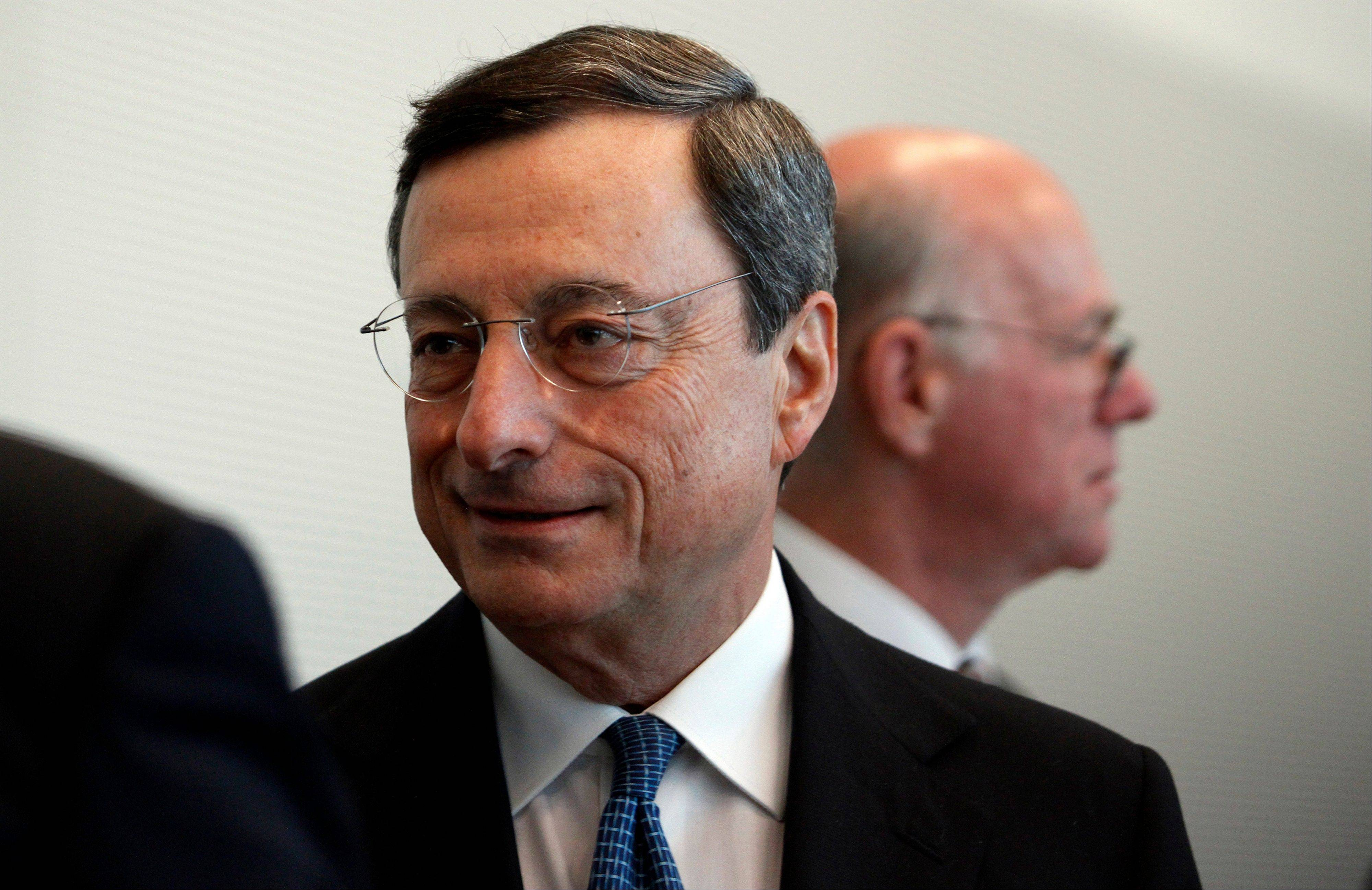 Mario Draghi, president of the European Central Bank (ECB), center, arrives to speak to lawmakers in the lower-house of the German parliament in Berlin, Germany, on Wednesday, Oct. 24, 2012. Draghi defended his plan to buy government bonds in the German parliament today with a warning about deflation risks.