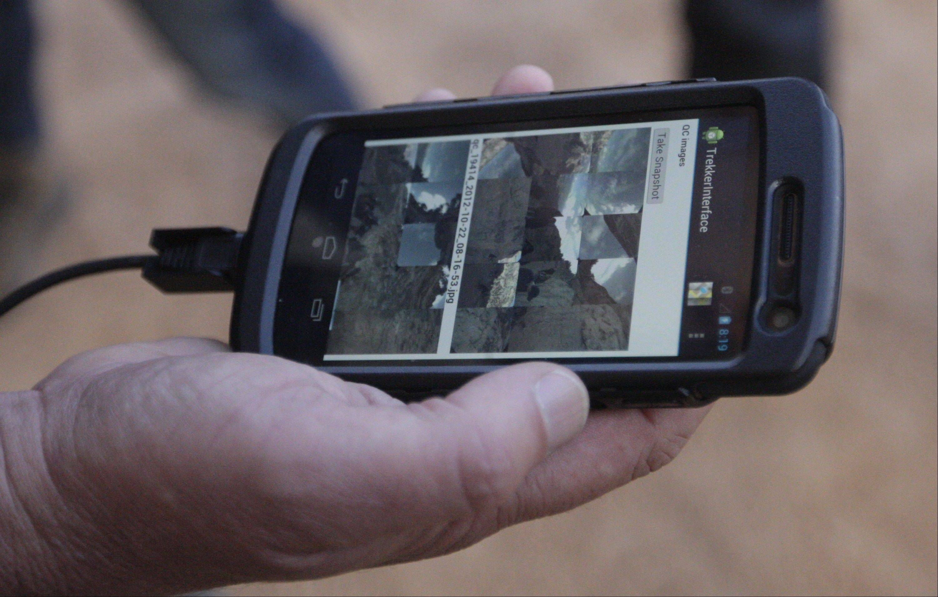 Low-resolution images of photos gathered by the Trekker are displayed on an Android phone.