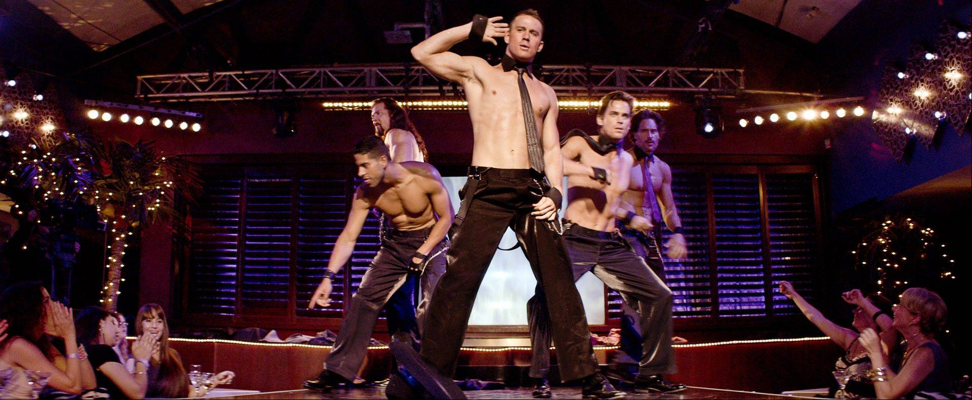 "Male dancer Mike (Channing Tatum), center, entertains female fans in ""Magic Mike."""