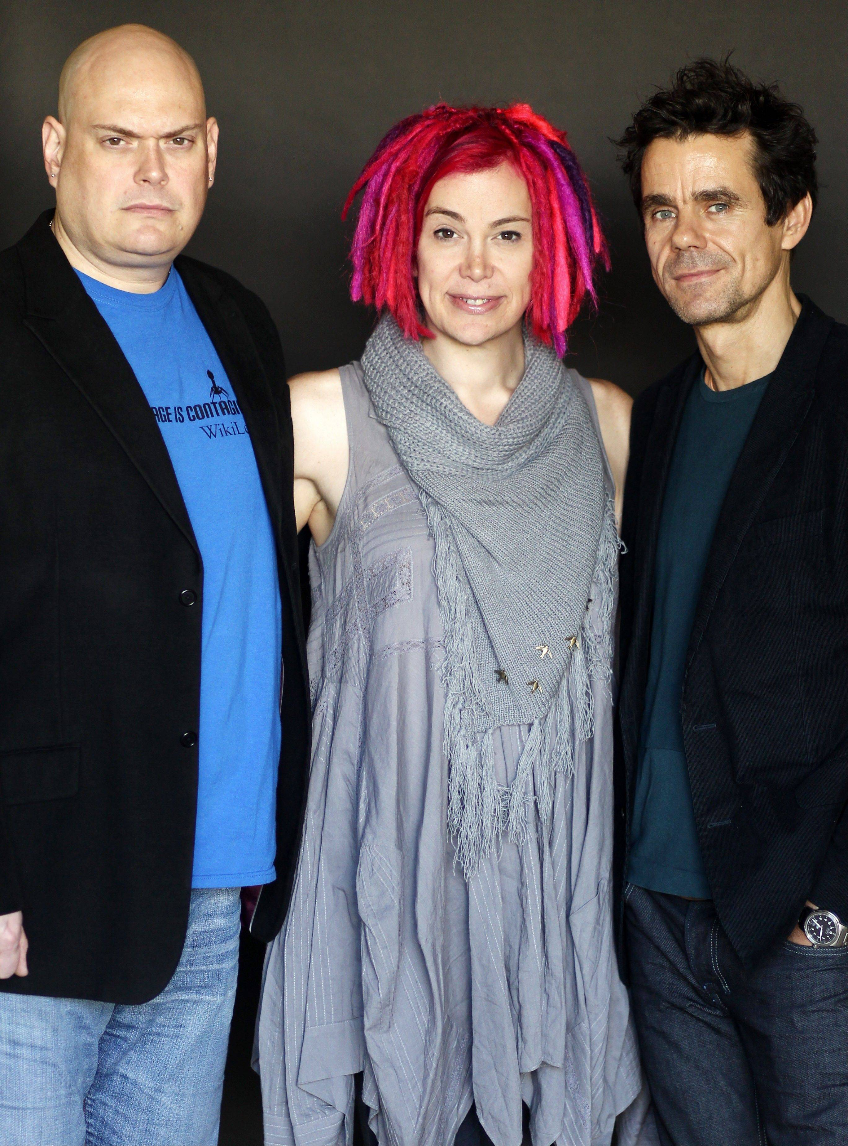"Directors-screenwriters Andy Wachowski, left, Lana Wachowski, center, and Tom Tykwer, guided the upcoming film ""Cloud Atlas"" and its large cast of stars."
