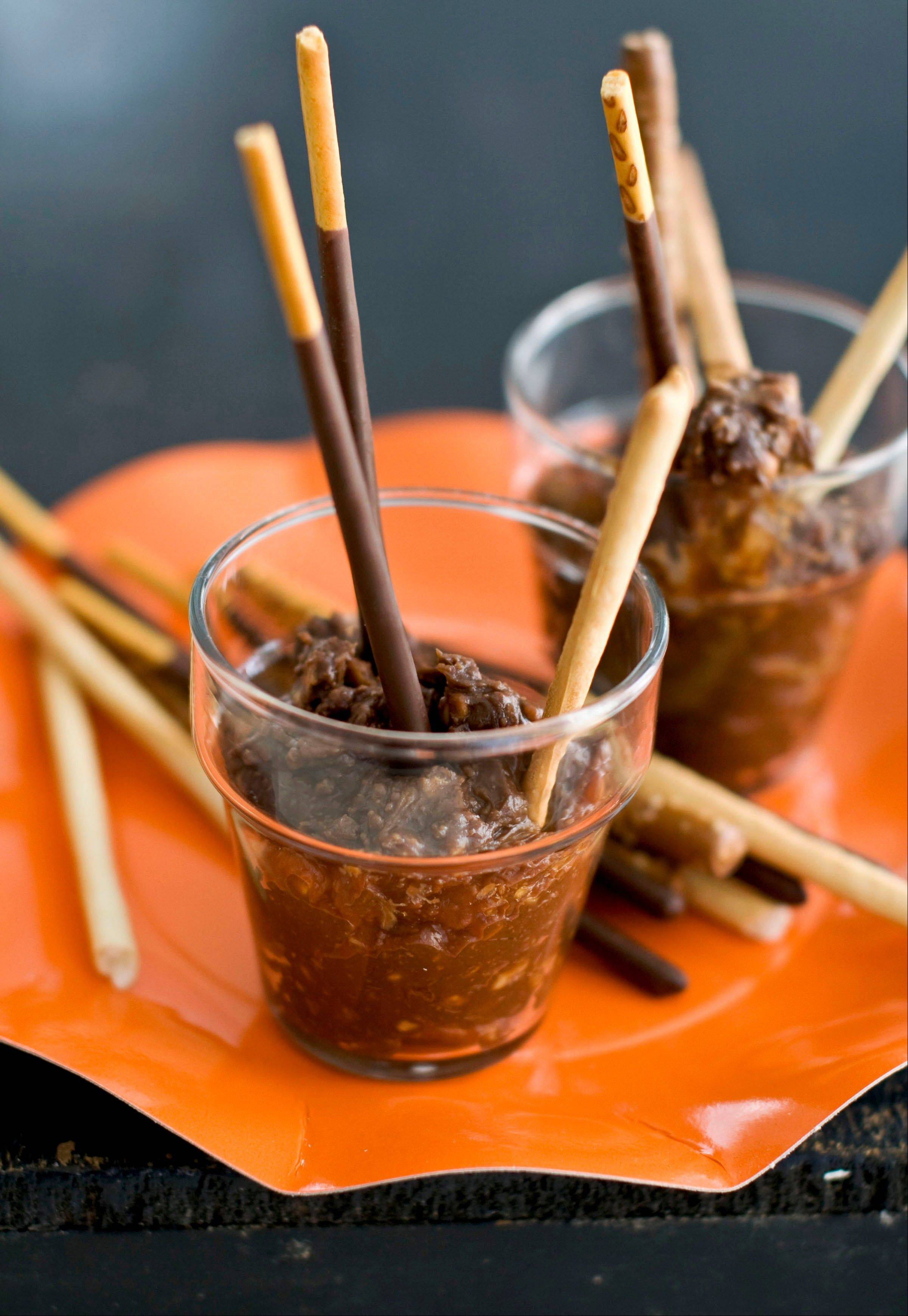 Let the goblins at your Halloween party get down and dirty with gooey, yummy Pots of Mud.