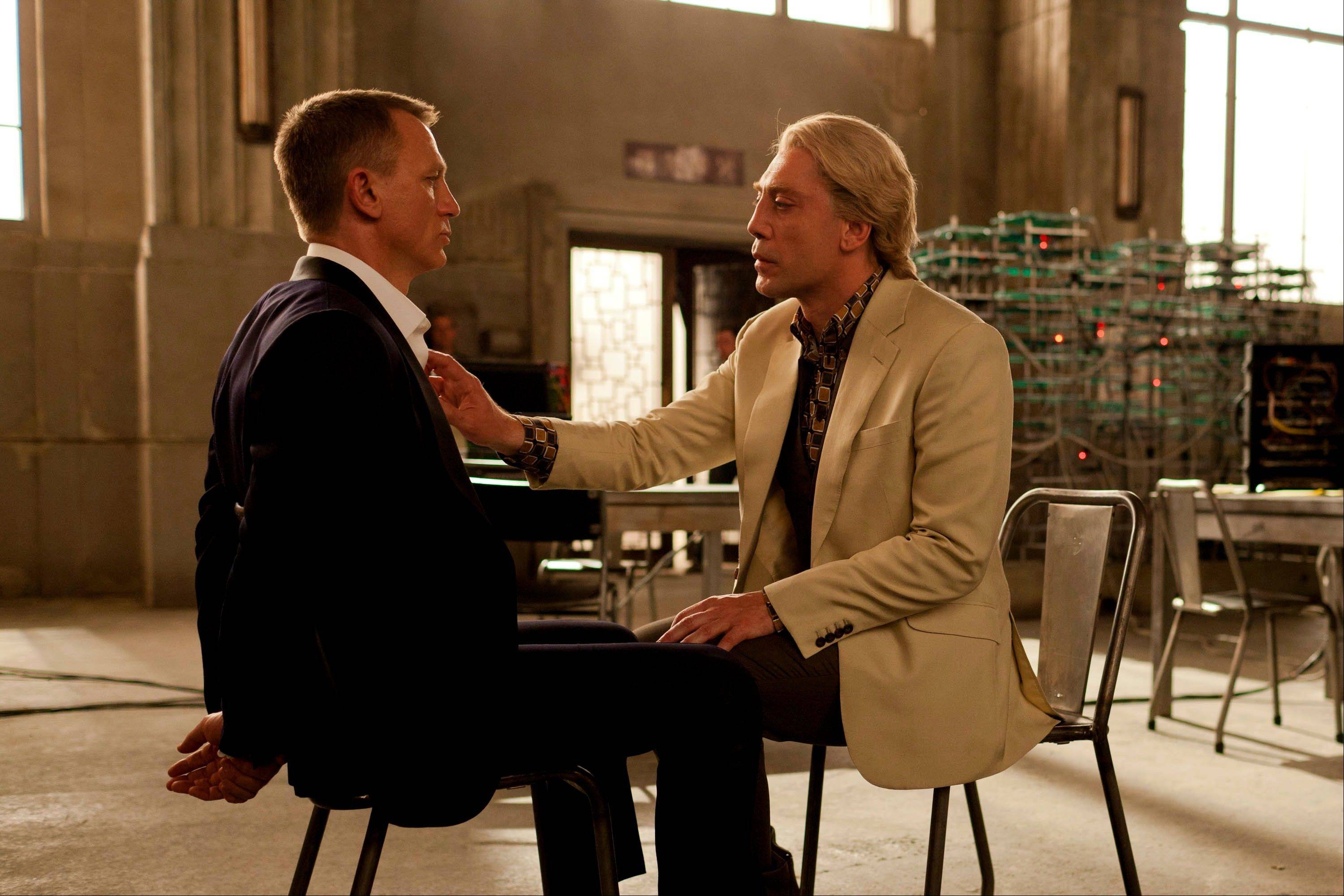 "Raoul Silva (Javier Bardem), right, toys with a tied-up James Bond (Daniel Craig) in ""Skyfall."""