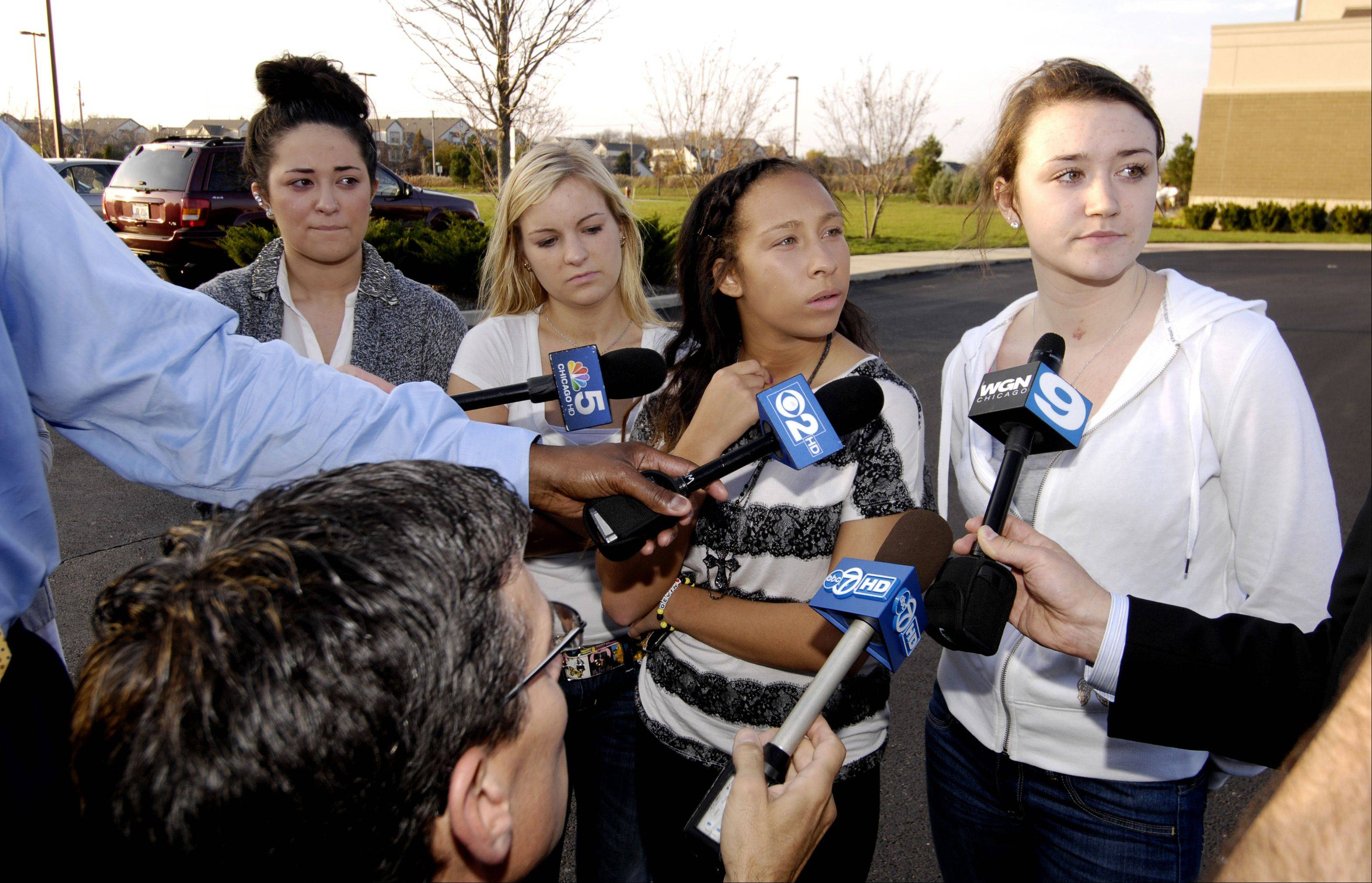 A group of teens talk to reporters before a prayer service at Faith Lutheran Church in Aurora held to remember Devin Meadows, who was killed in an auto accident Tuesday morning.