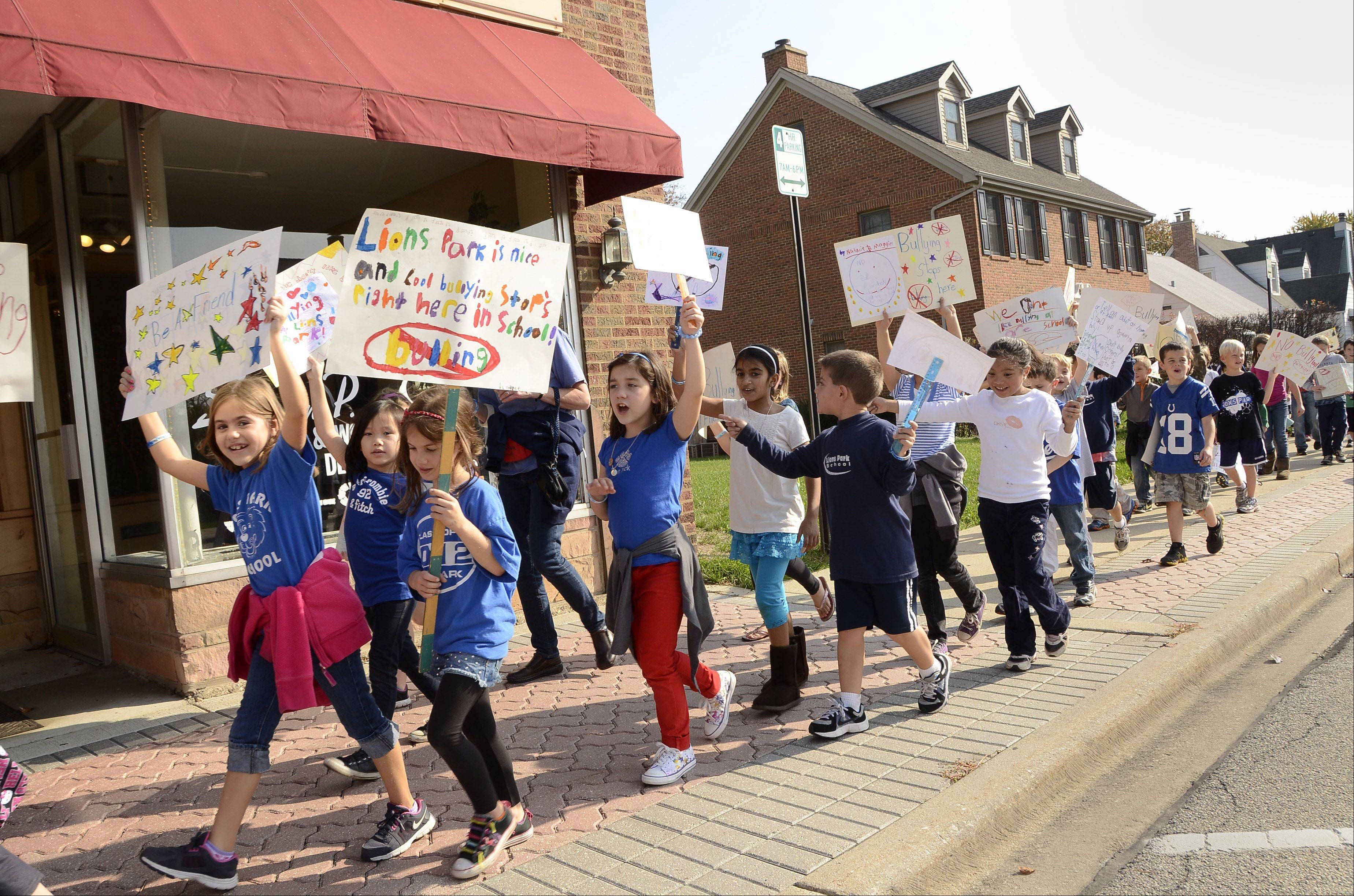 Lions Park School students march in downtown Mount Prospect carrying anti-bullying signs they made for the event. The march was part of the first Stand Up to Bullying Week in Mount Prospect Elementary District 57.