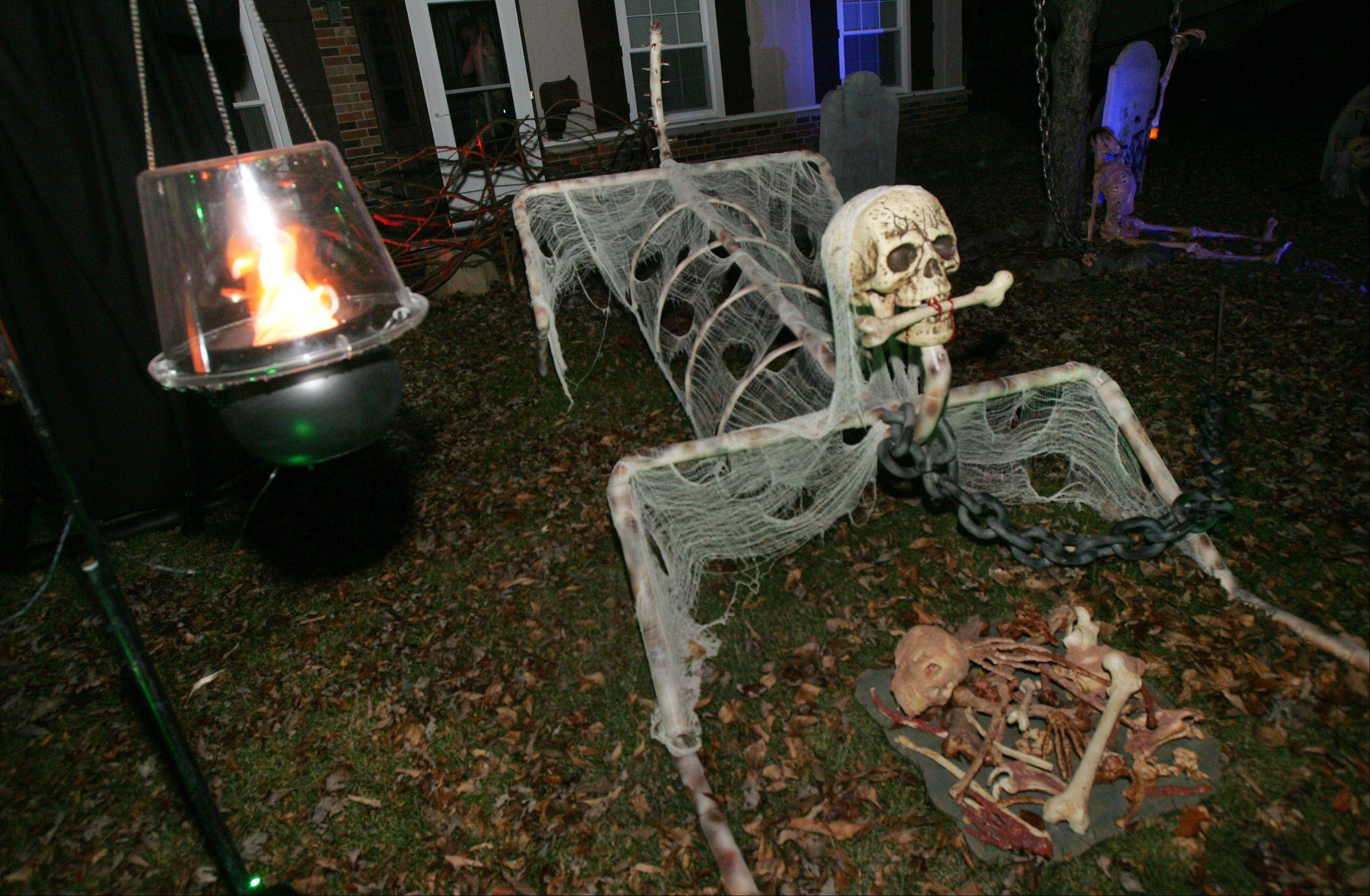 Fluffy guards the front yard of Todd and Mickey Horndasch's haunted house display on Old Mill Grove Road in Lake Zurich.