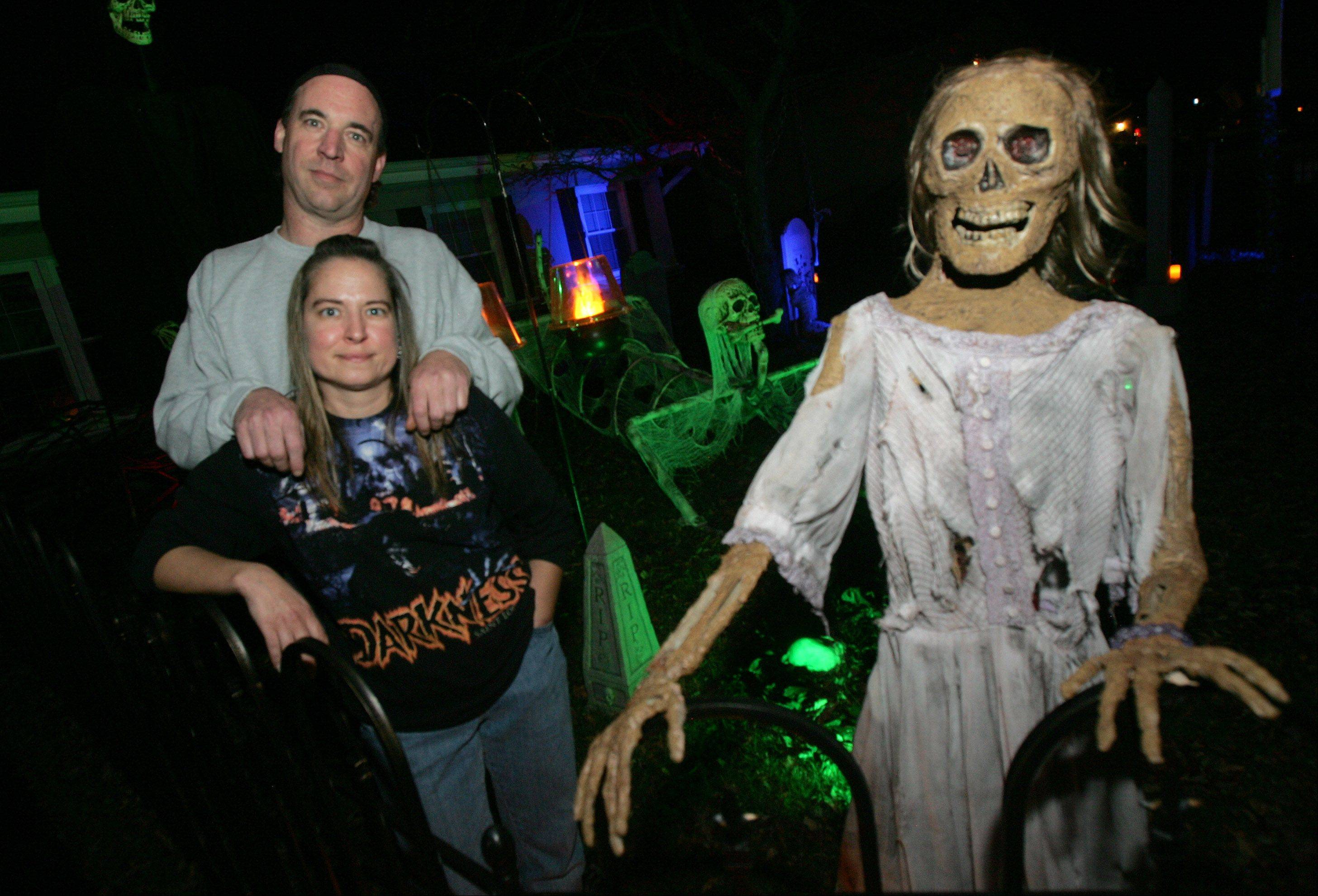 Lake Zurich residents Todd and Mickey Horndasch at their haunted home on Old Mill Grove Road. Visitors are asked to bring nonperishable donations for a weekly church food pantry and a local pet rescue.