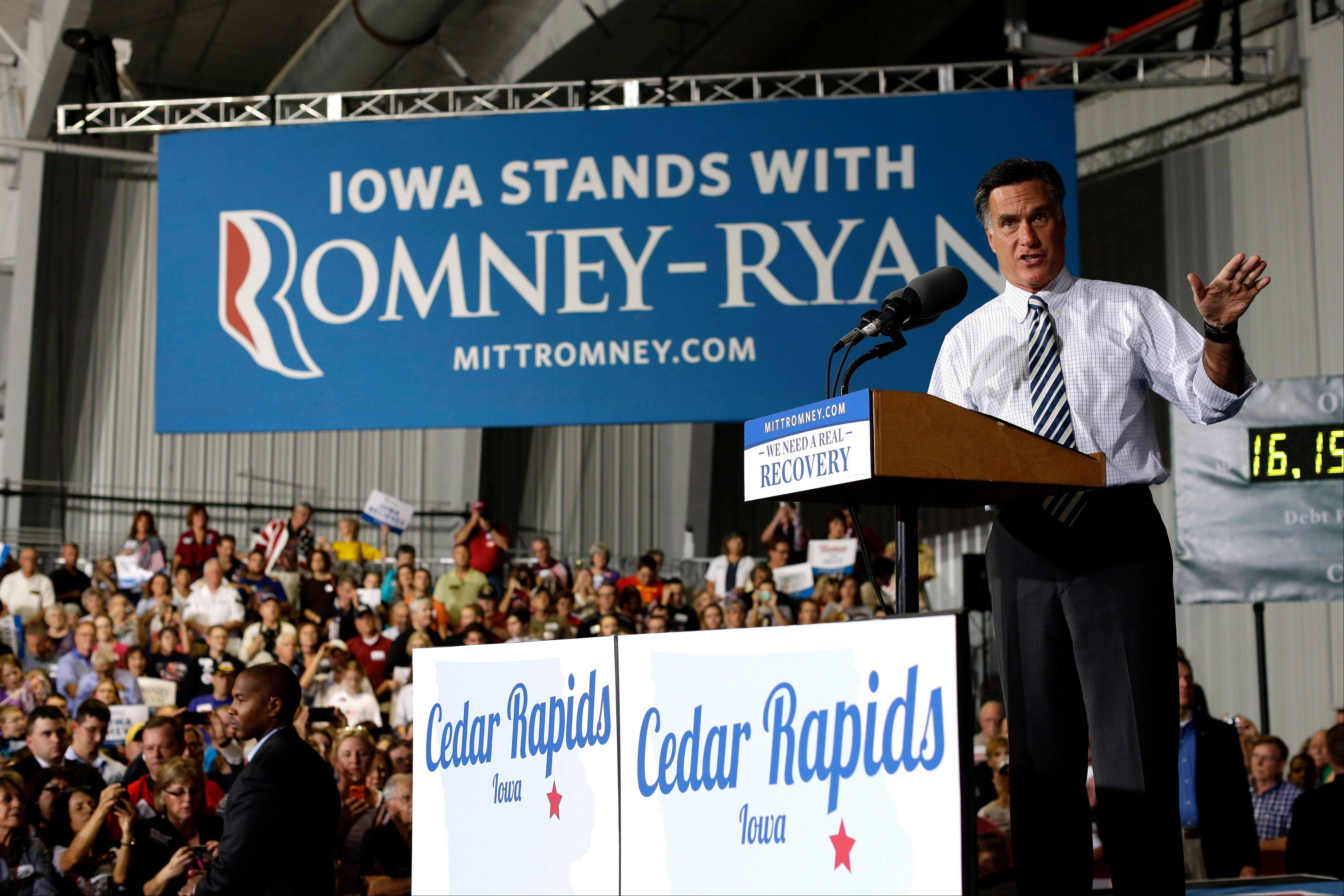 Republican presidential candidate former Massachusetts Gov. Mitt Romney campaigns in Cedar Rapids, Iowa, Wednesday.