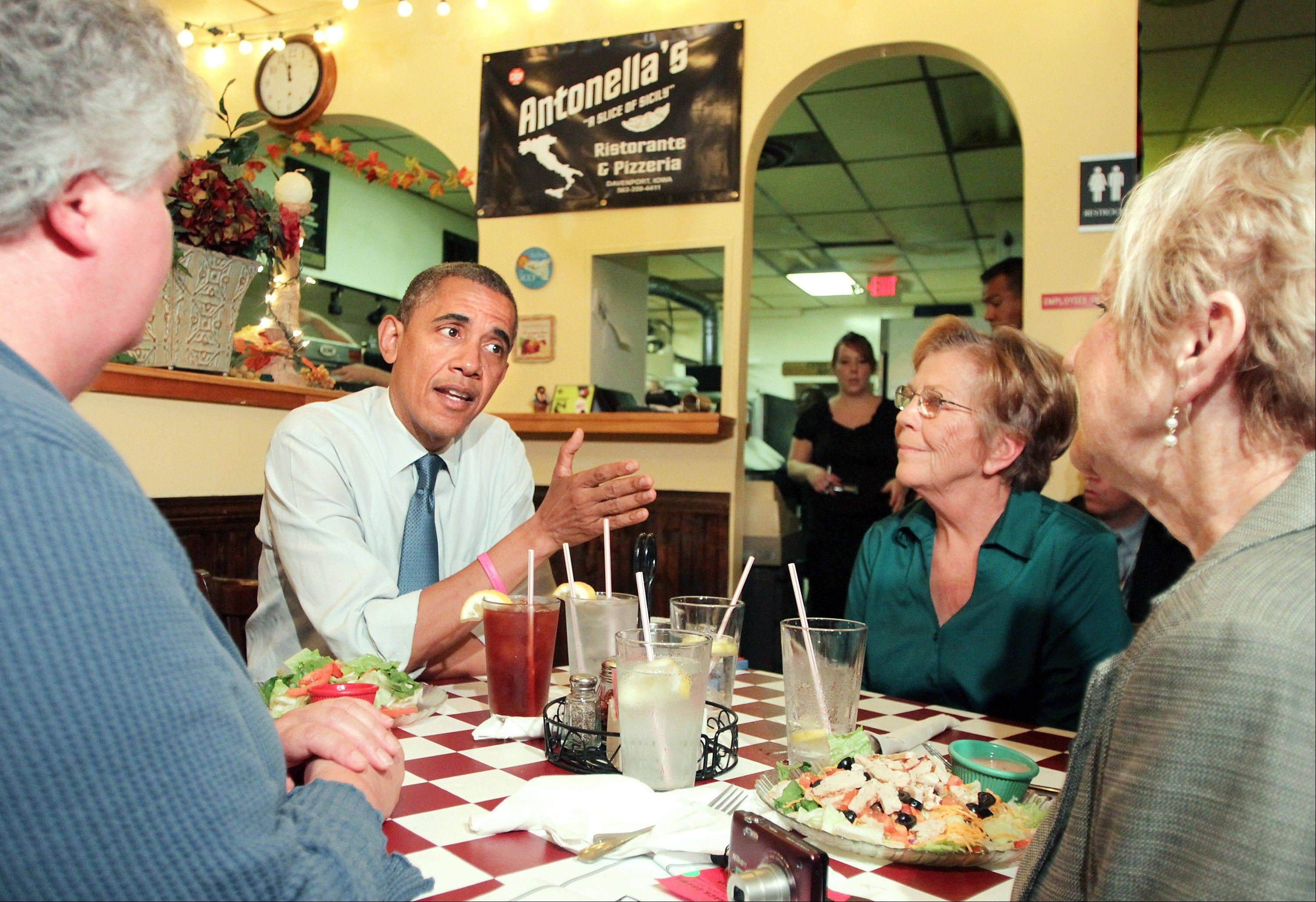 President Barack Obama talks with residents in Davenport, Iowa, Wednesday.