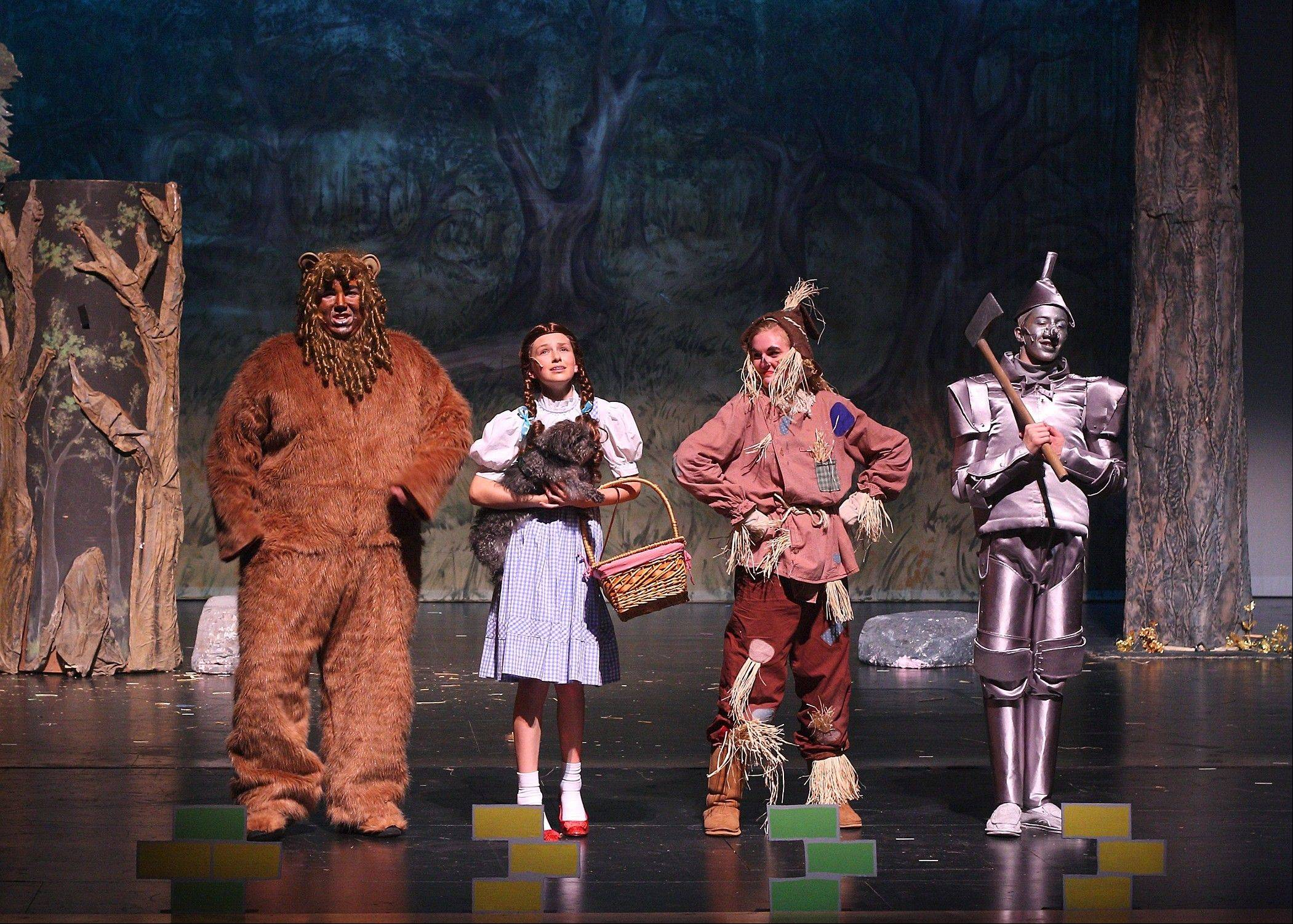 "Keith Mankowski, as the Lion, left, Shannon McCoy as Dorothy, Kayla Nicosia as Scarecrow and Joshua Dille as the Tinman lead a cast of 60 in Spotlight Youth Theater's production of ""The Wizard of Oz."" Shows are set for Friday, Oct. 26 through Sunday, Oct. 28 at the Batavia Fine Arts Center."